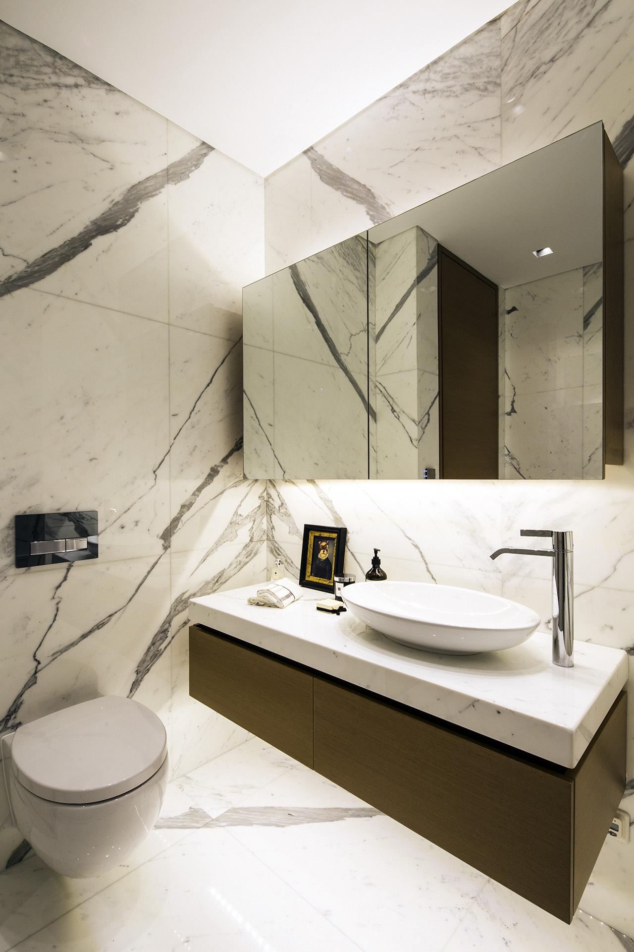 Custom designed bathroom with book-match marble.