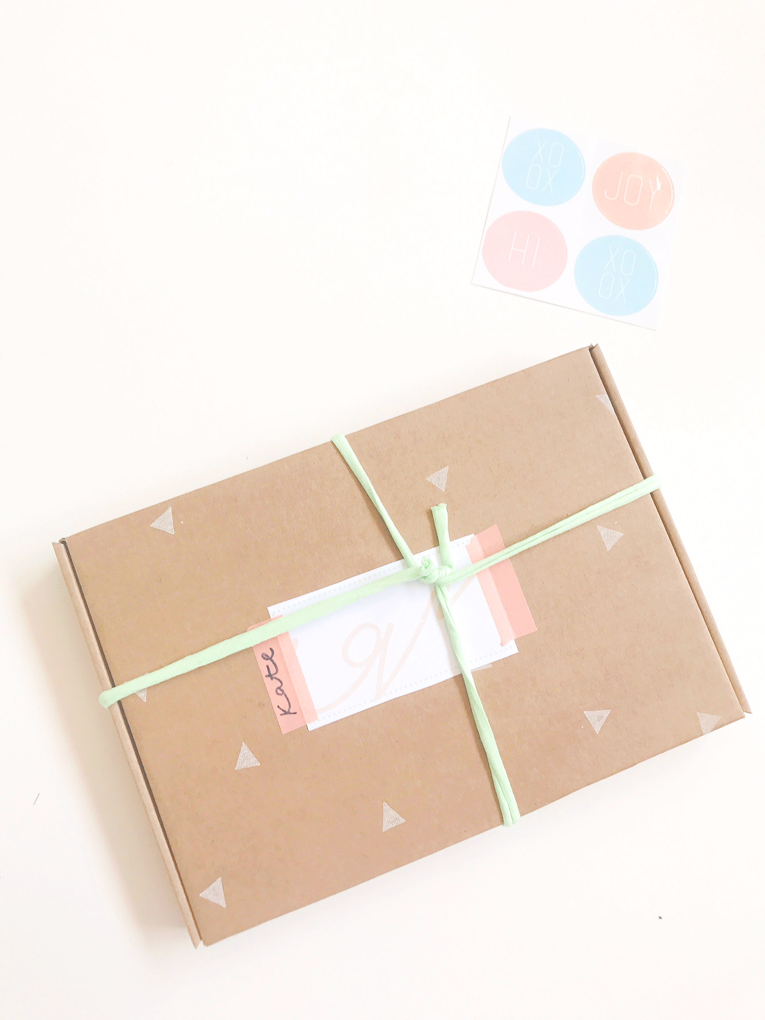 The larger size free label downloads will fit over your address label sticker, just use your washi tape or sellotape to stick down. Tie with ribbon or raffia if you have any. Get creative with writing your recipients name on the label, washi tape or box. Your gift is wrapped, you're ready to go!