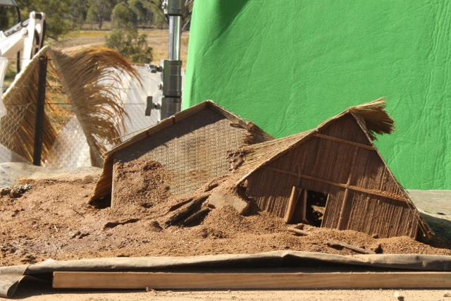 miniature flood destroyed village huts to be composited into background in post
