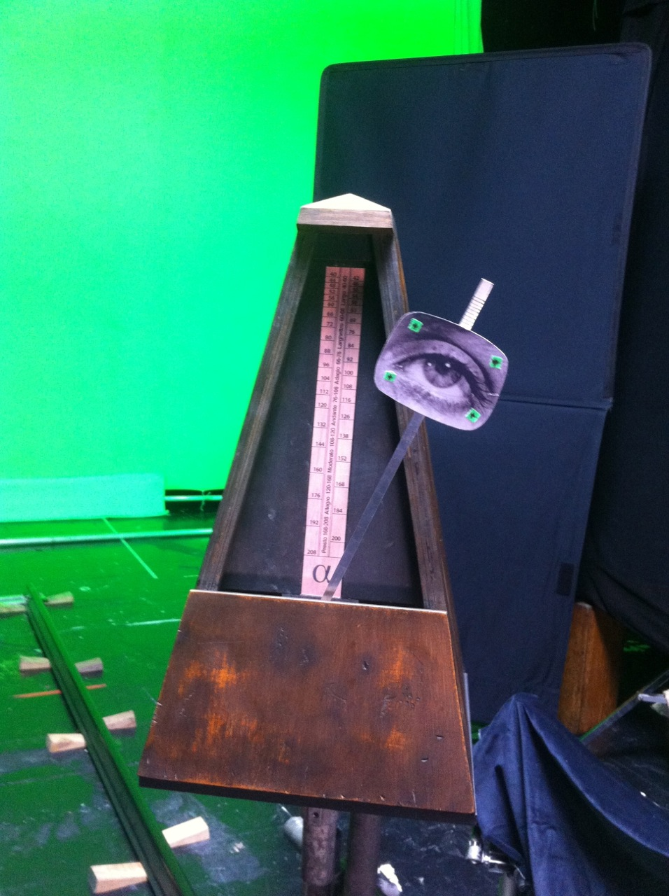 oversized metronome prop on set