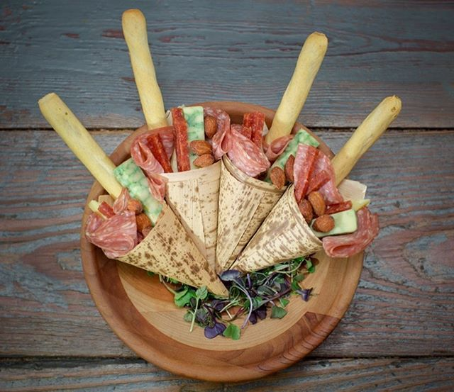 For that moment when you have to make that split second decision of food or bar, we have the solution! Grab one of our Charcuterie Cones on the go! #larootscatering