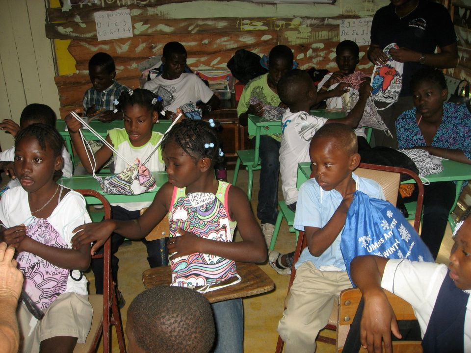 Children receiving new backpacks and Bibles