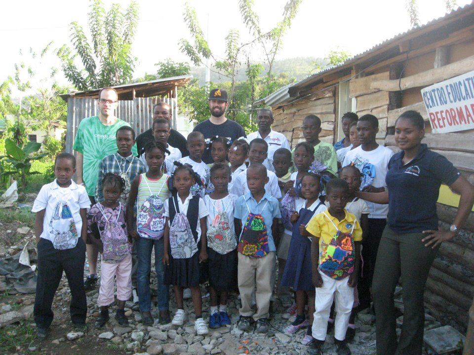 Haitian students receiving backpacks and Bibles