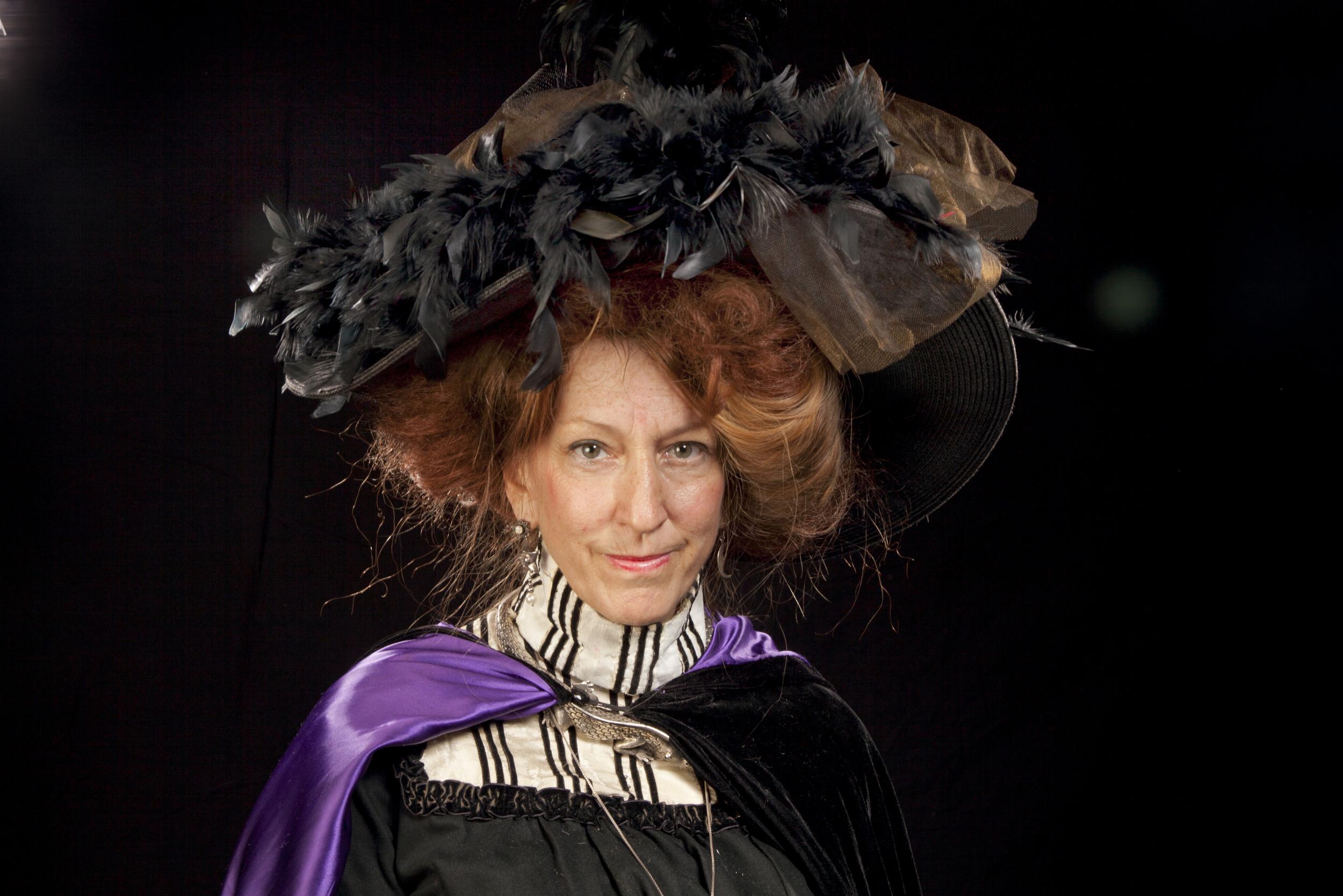 Large black feather hat, puple capeIMG_4381.jpg