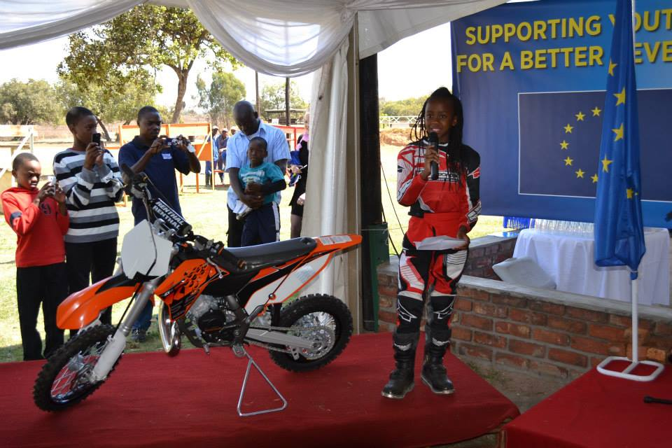 Hand over Ceremony of a KTM 65cc to Tanya by the EU Delegation of Zimbabwe