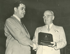 President Truman awards George E. Barr the 1951 President's Award for his contribution to employment of people with disabilities.
