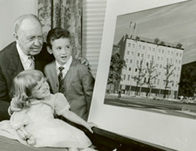 Founder Jeremiah Milbank Sr. looks at new building plans with pediatric patients in 1962.