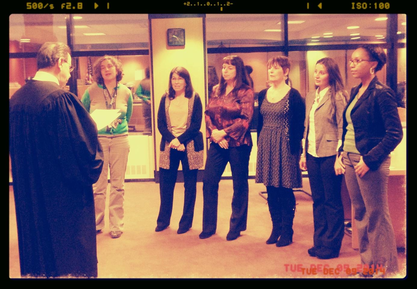 Judge Joseph A. Portelli administering the Oath of Office to (left to right) Naomi Gamorra, Mary Dykes, Denise Damiano, Jo-Ann Pinheiro, Sebahat Guven, and Sosha Stewart at the Passaic County Superior Courthouse.