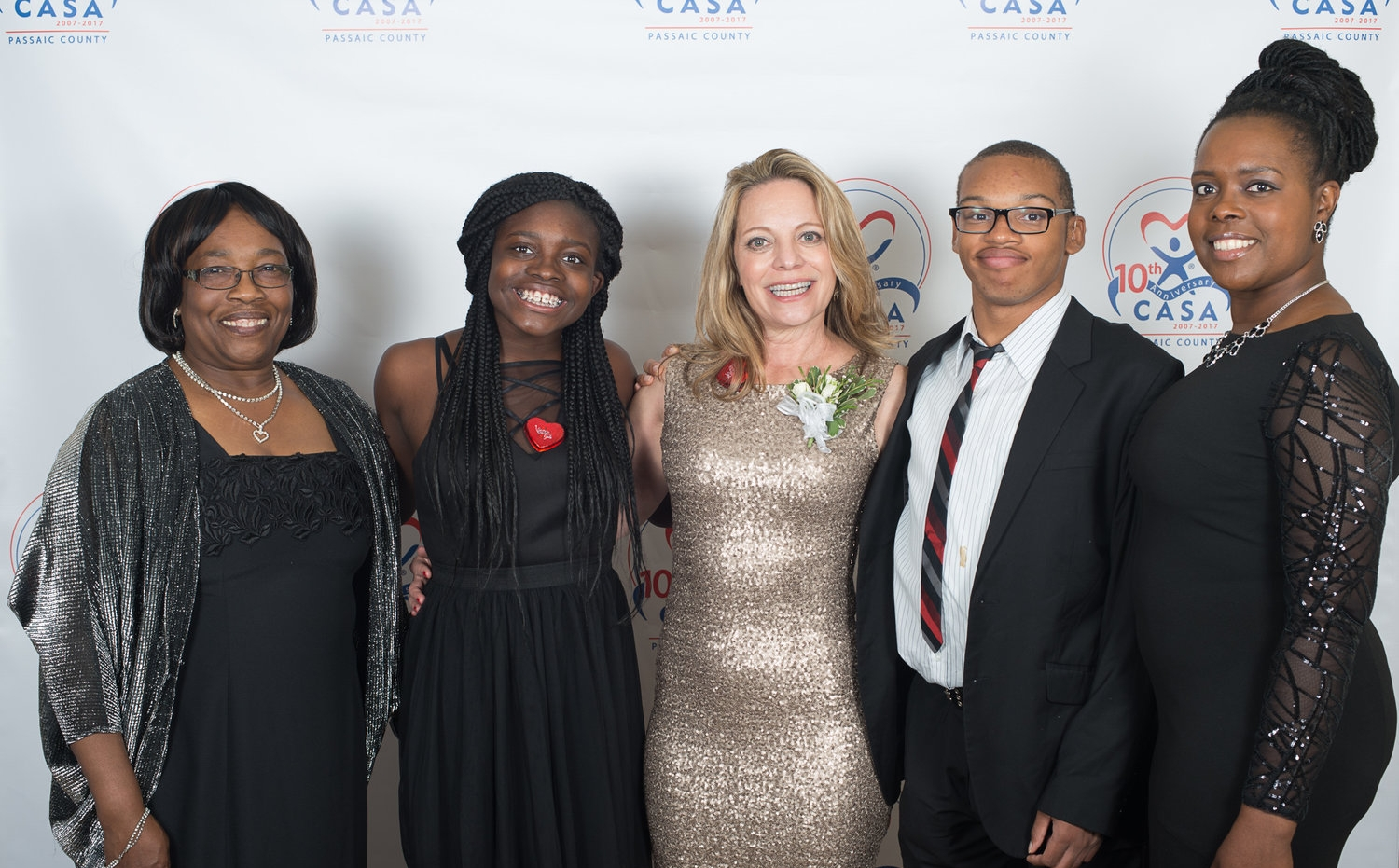 CASA volunteer Ann Rose, Tommy Williams, his mother Martha, and other family members at the Voices for Children Gala.