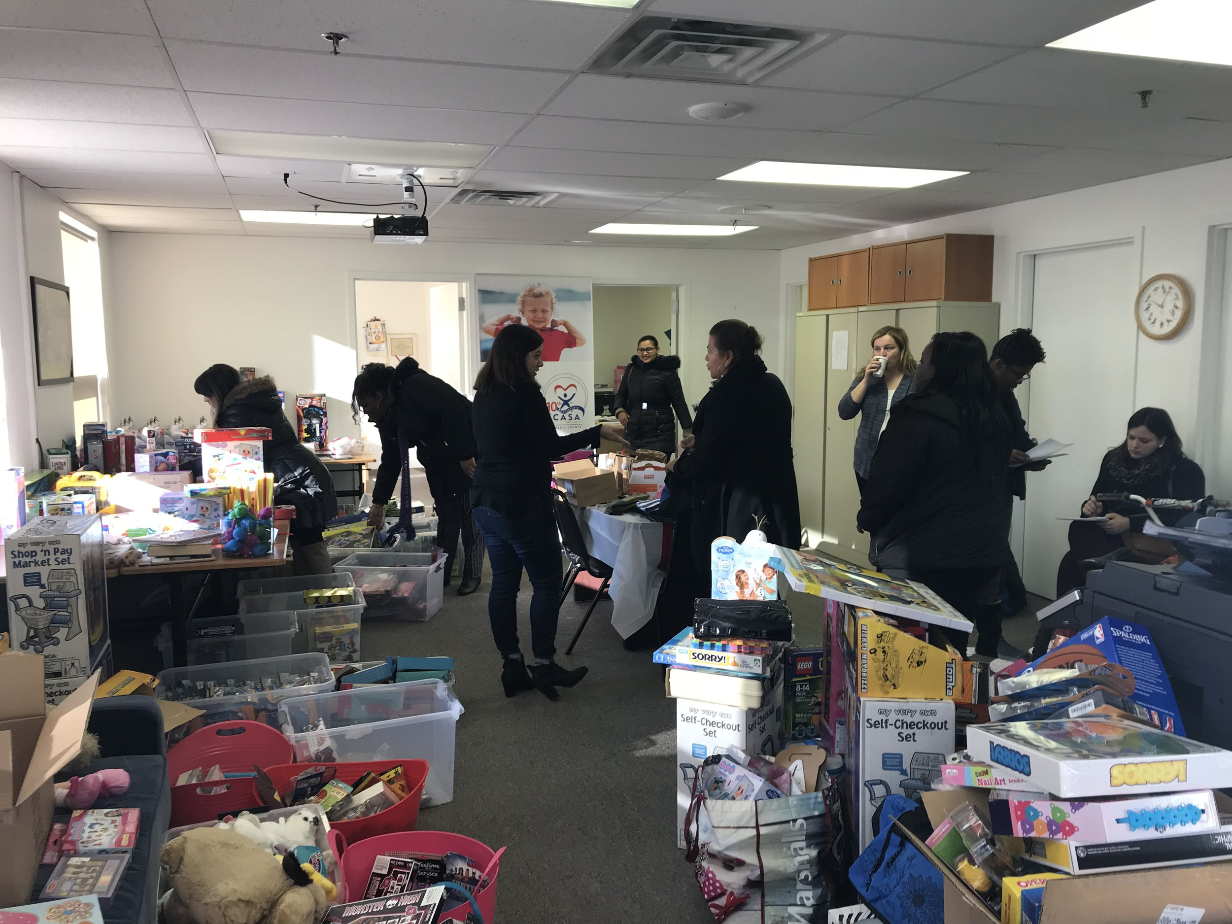 Caseworkers from the Division of Child Protection and Permanency (DCP&P) pick up gifts for children in the child welfare system who aren't in foster care.