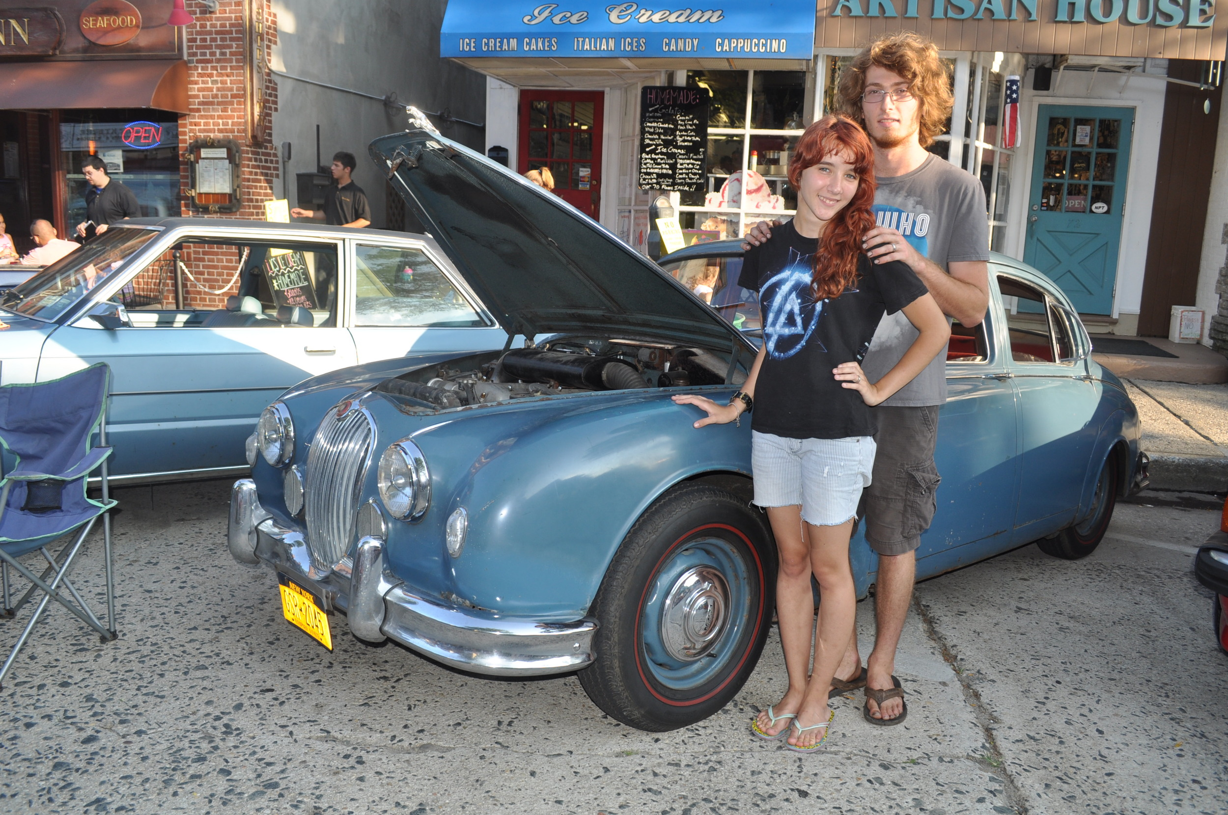 Eric Johnson and Veronika Potylitsina show off the vintage Ford hotrod - one of dozens of classic cars on display.