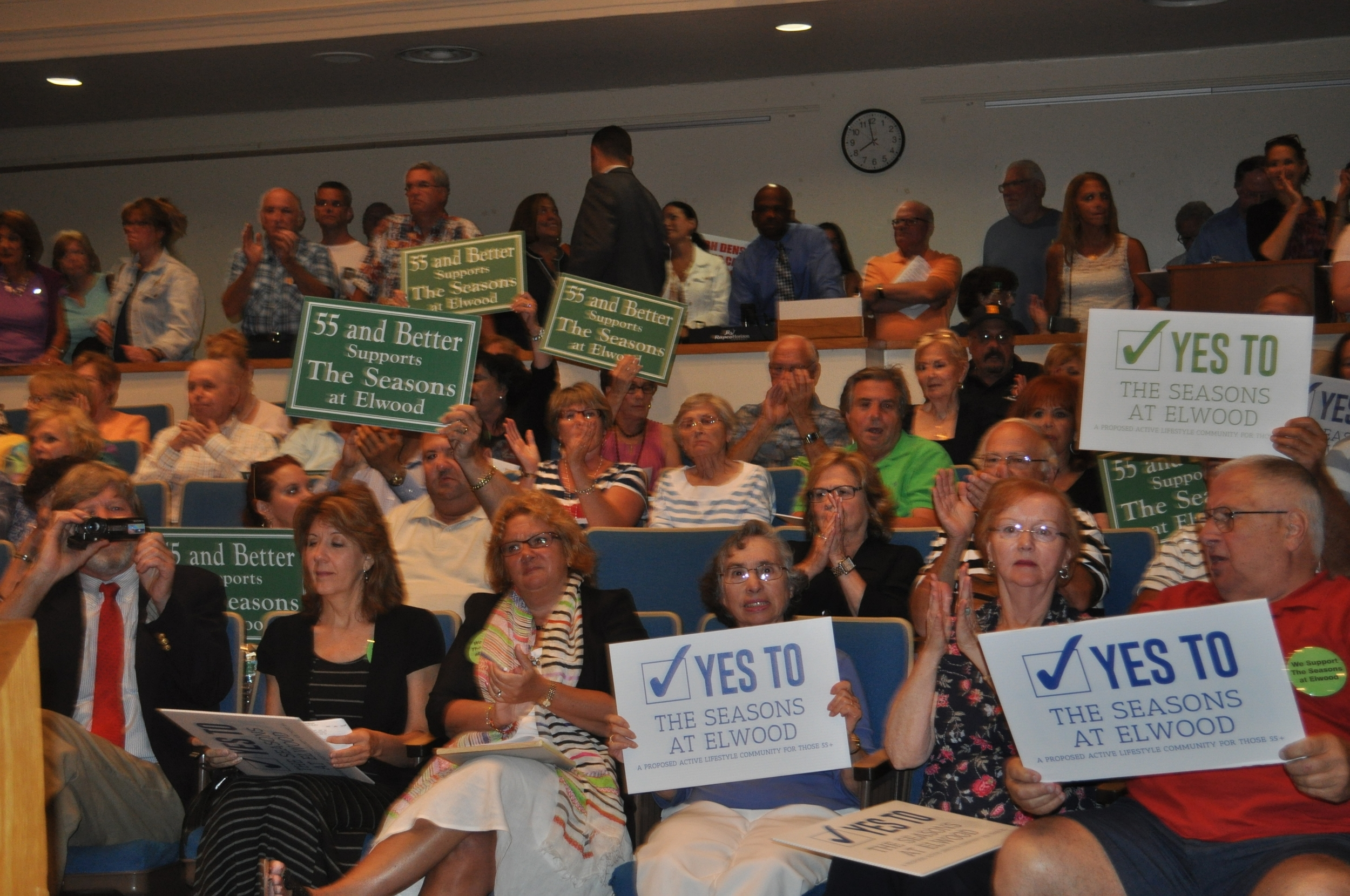 Supporters of The Seasons at Elwood celebrate the town board's 4-1 vote Tuesday to approve a zone change needed for the 256-unit senior community at the Oak Tree Dairy.