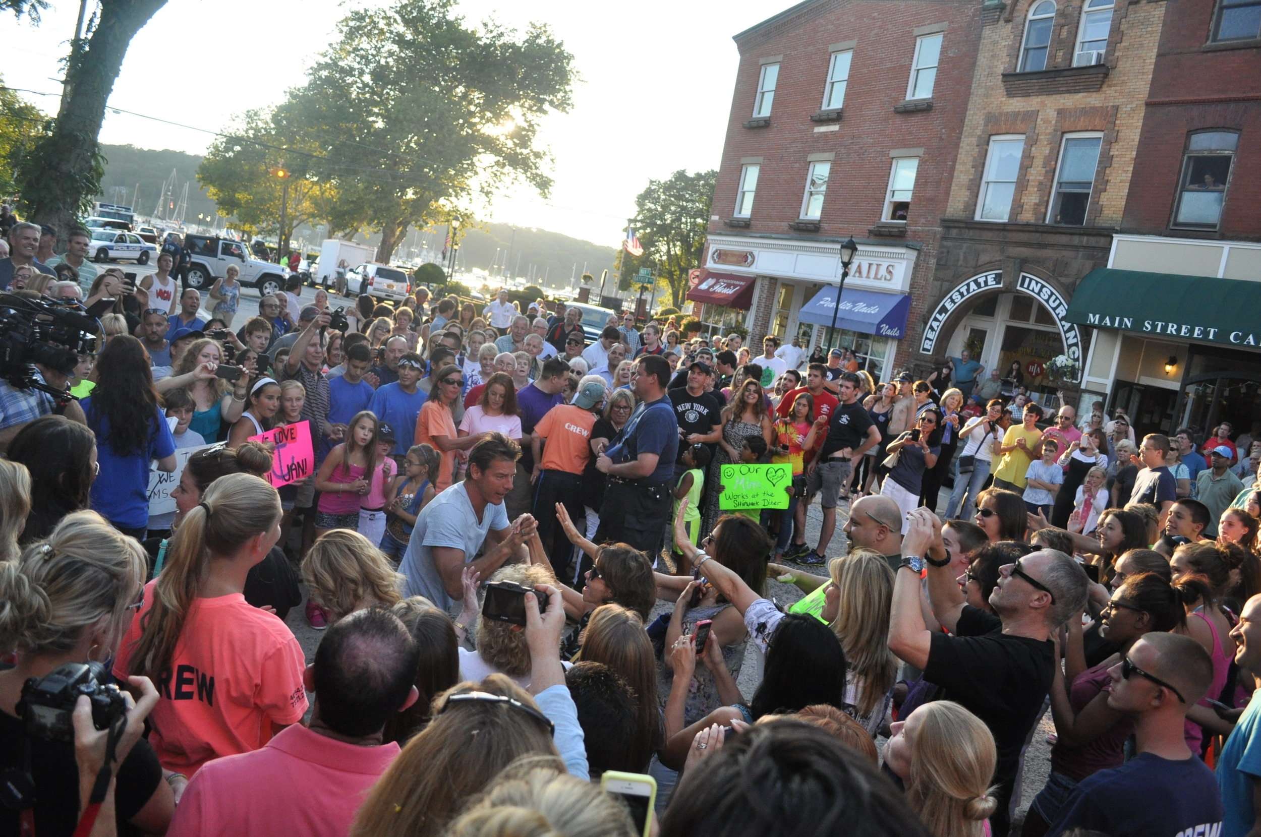 "Ty Pennington, host of Food Network pilot ""American Diner Revival,"" works the crowd on Main Street before Tim Hess, owner of the Shipwreck Diner, arrives."