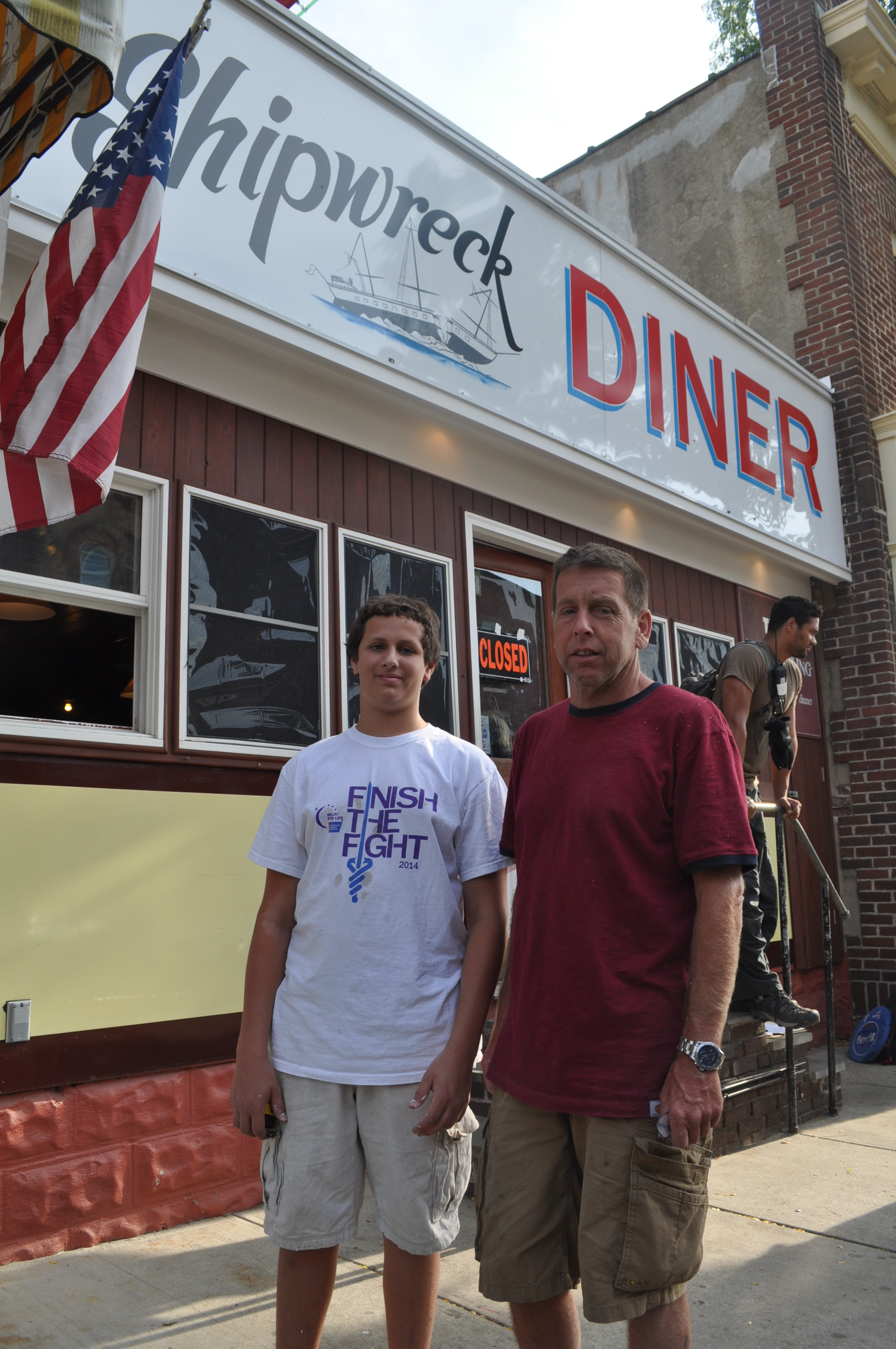 Riley Ziegler and John Ehrhardt, both of East Northport, were among the more than 200 volunteers who helped transform Tim's Shipwreck Diner.