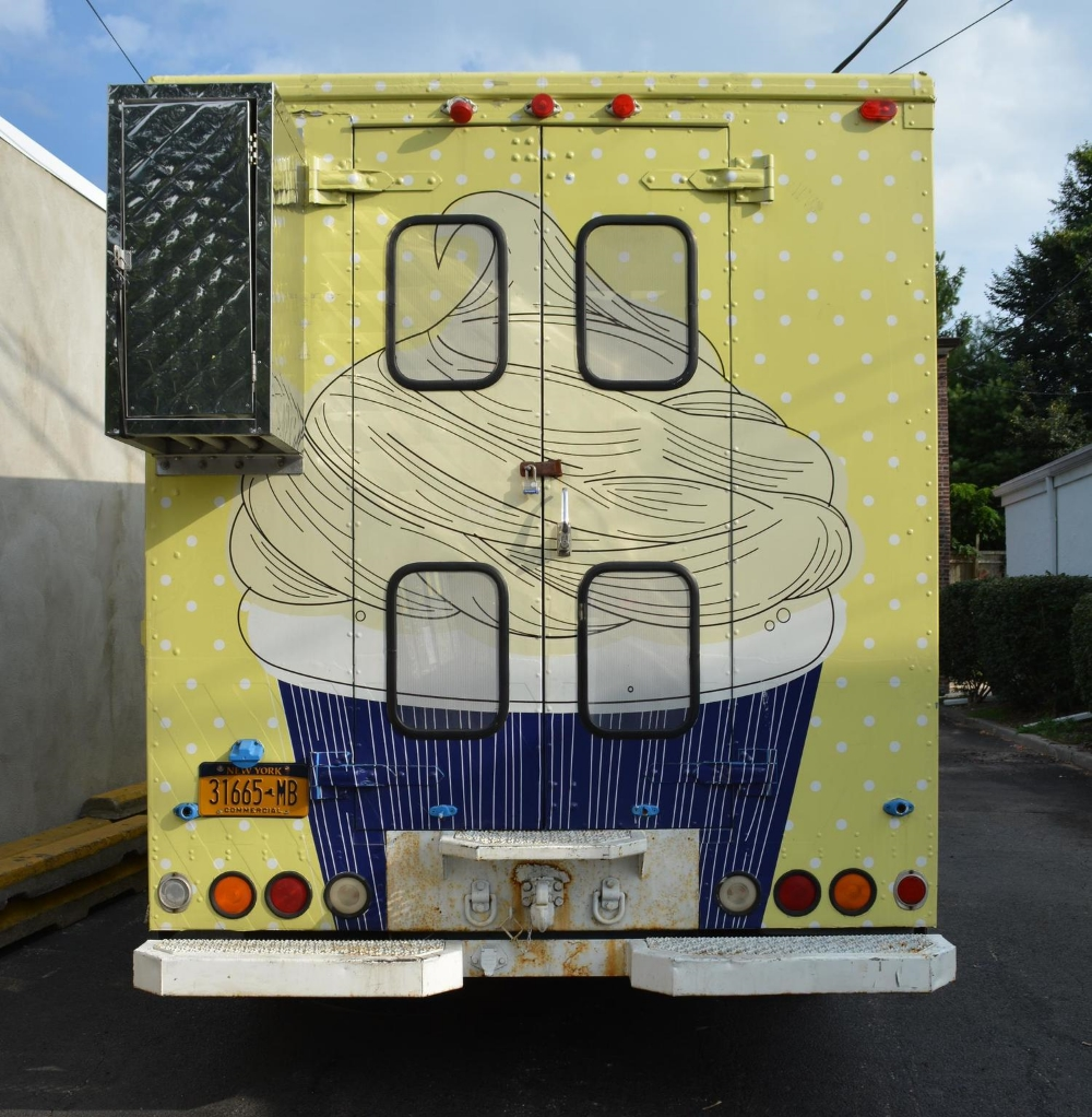 The back of the Blondie's Bake Shop truck, which features a giant cupcake graphic!
