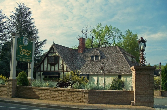 Centerport's Thatched Cottage and an adjacent lot are scheduled to go up for bids Sept. 24 in a bankruptcy auction.