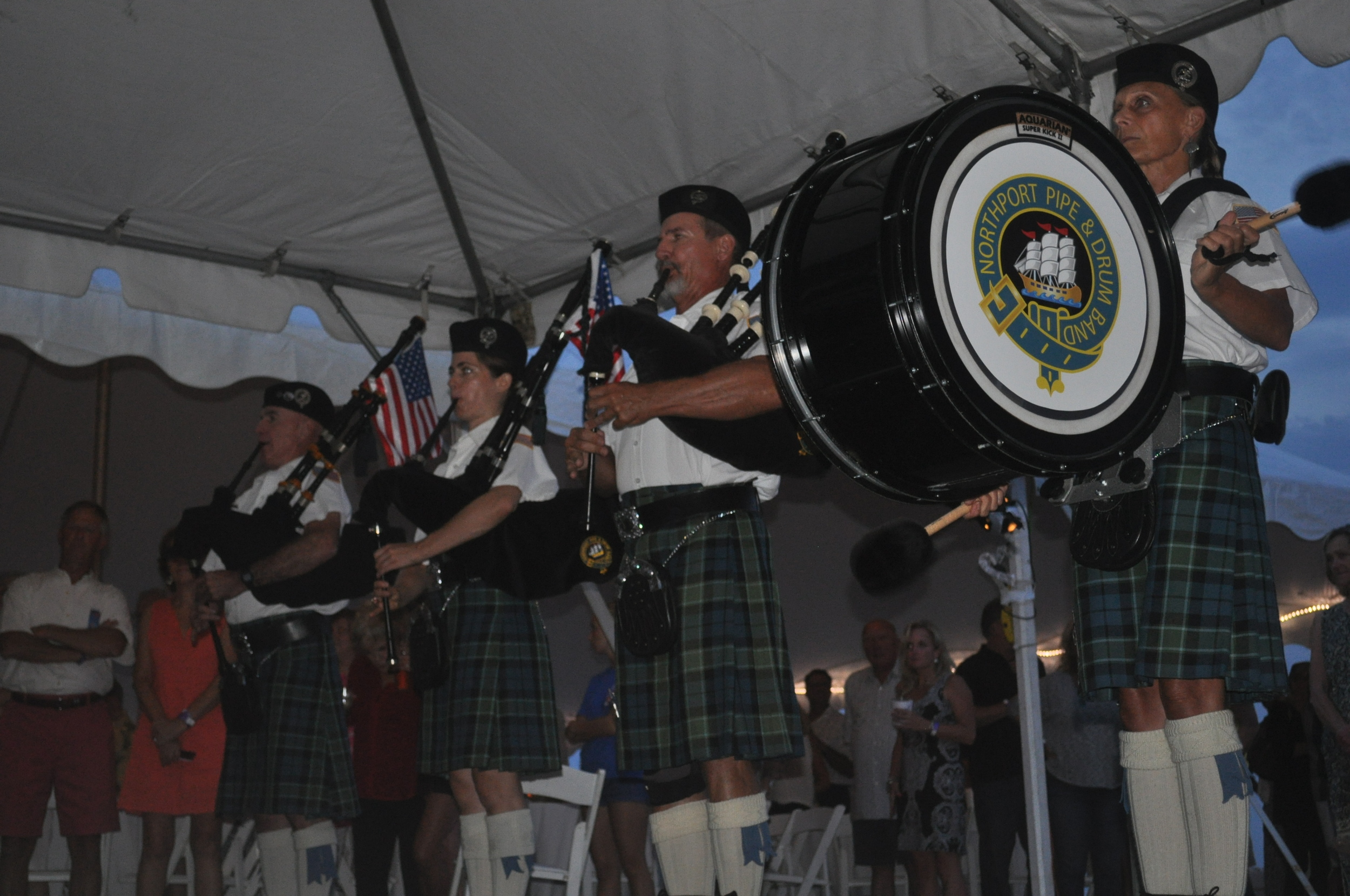 Members of the Northport Pipe & Drum Band perform at the clam bake ahead of the ceremonies.