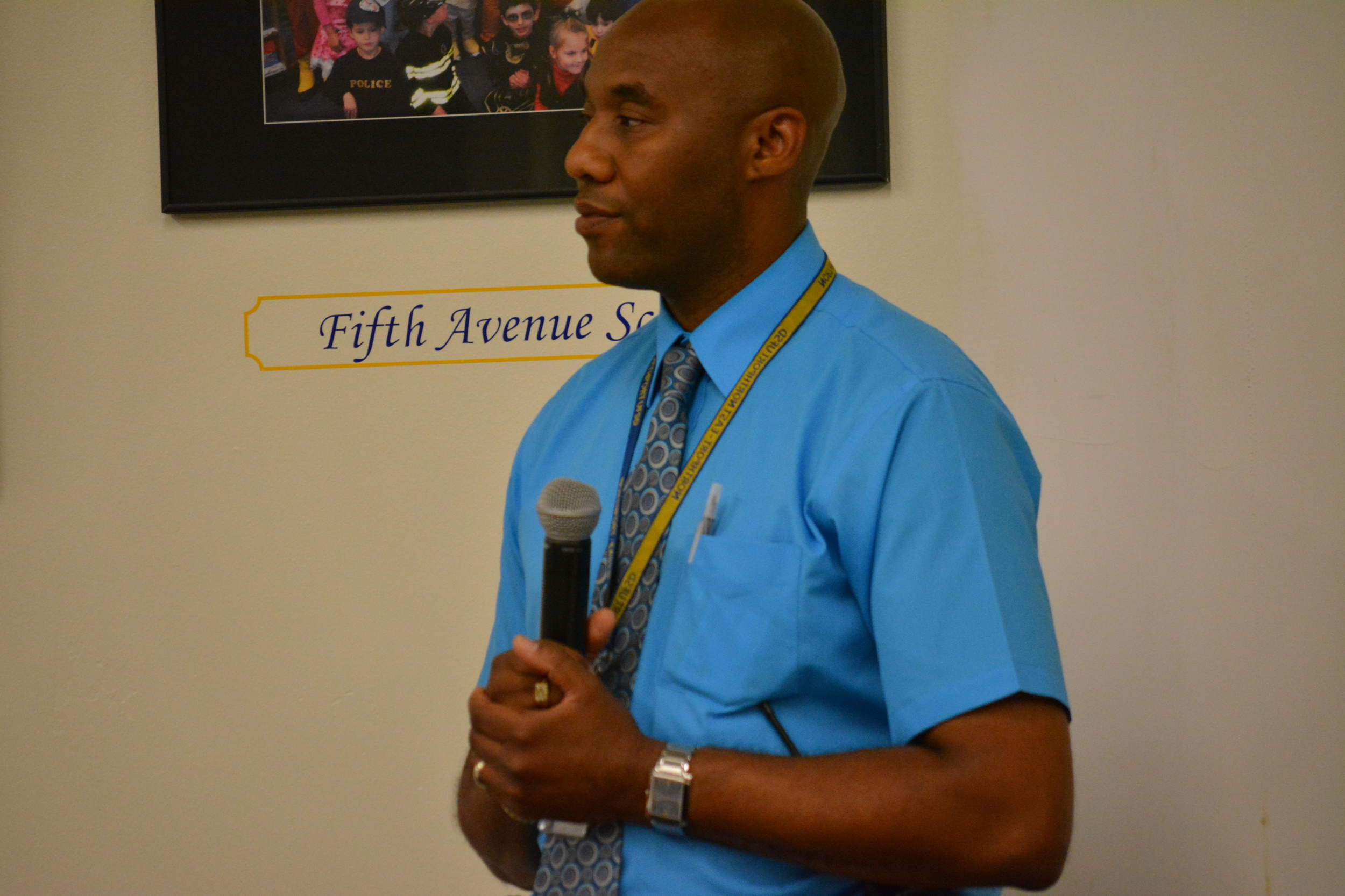 """Nolan Briggs, supervisor of security for the Northport-East Northport School District, explains a new """"visitor management system"""" being implemented into the district's secondary schools that will have visitors swipe a driver's license upon entry."""