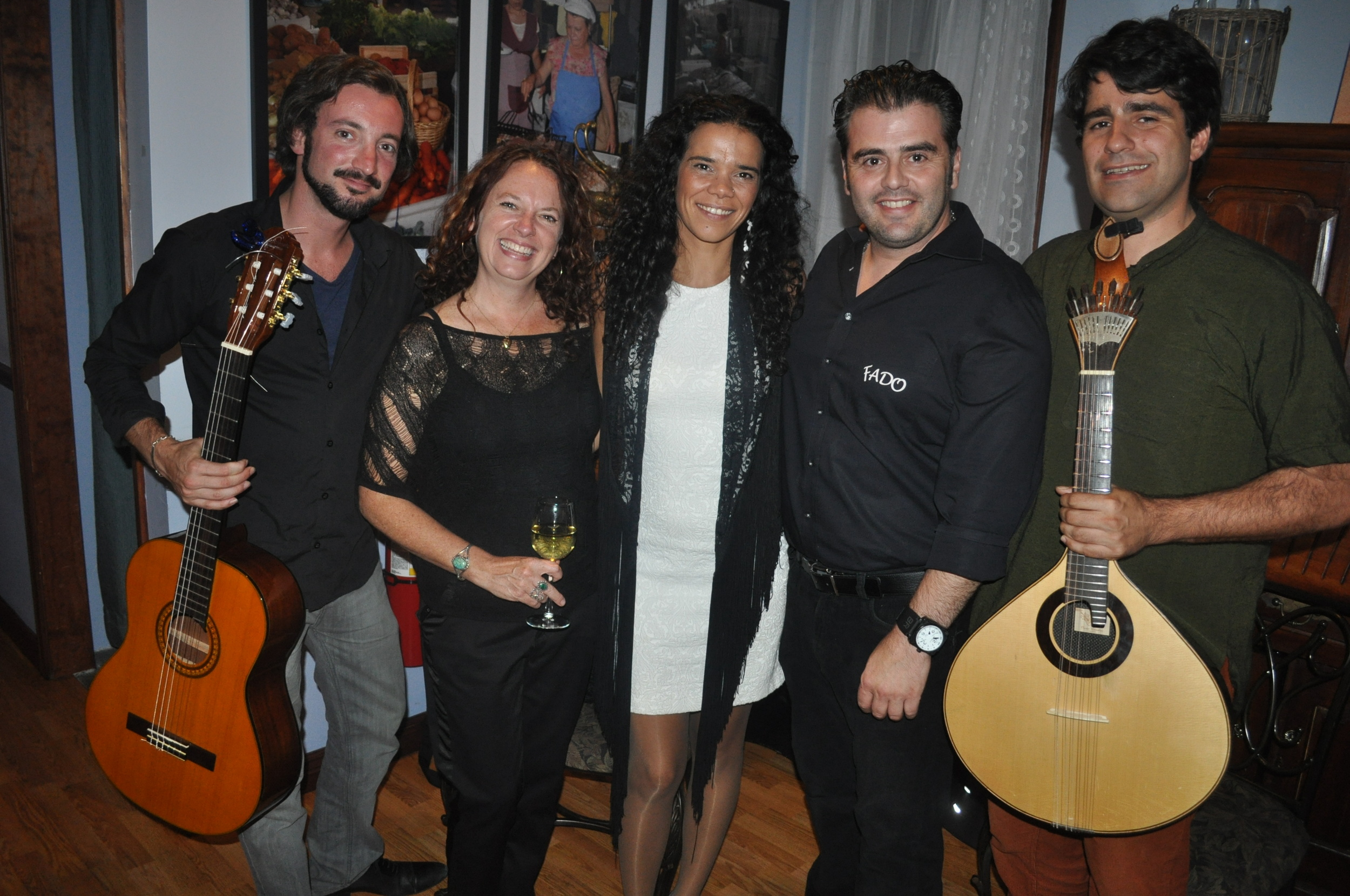 """Direct from Lisbon, """"Fadista"""" Claudia Duarte joined Fado owners Allison and Eddie Nobre, for an evening of traditional Portuguese favorites on Sunday. Duarte was accompanied by Paulo Croft, left, on viola fado (acoustic guitar) and Rui Martins, right, on the 12-string Portuguese Guitar."""