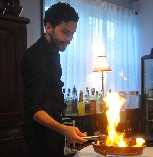 Ivo Duarte prepares Fado's signature starter, Chourico na Brasa, over an open flame.