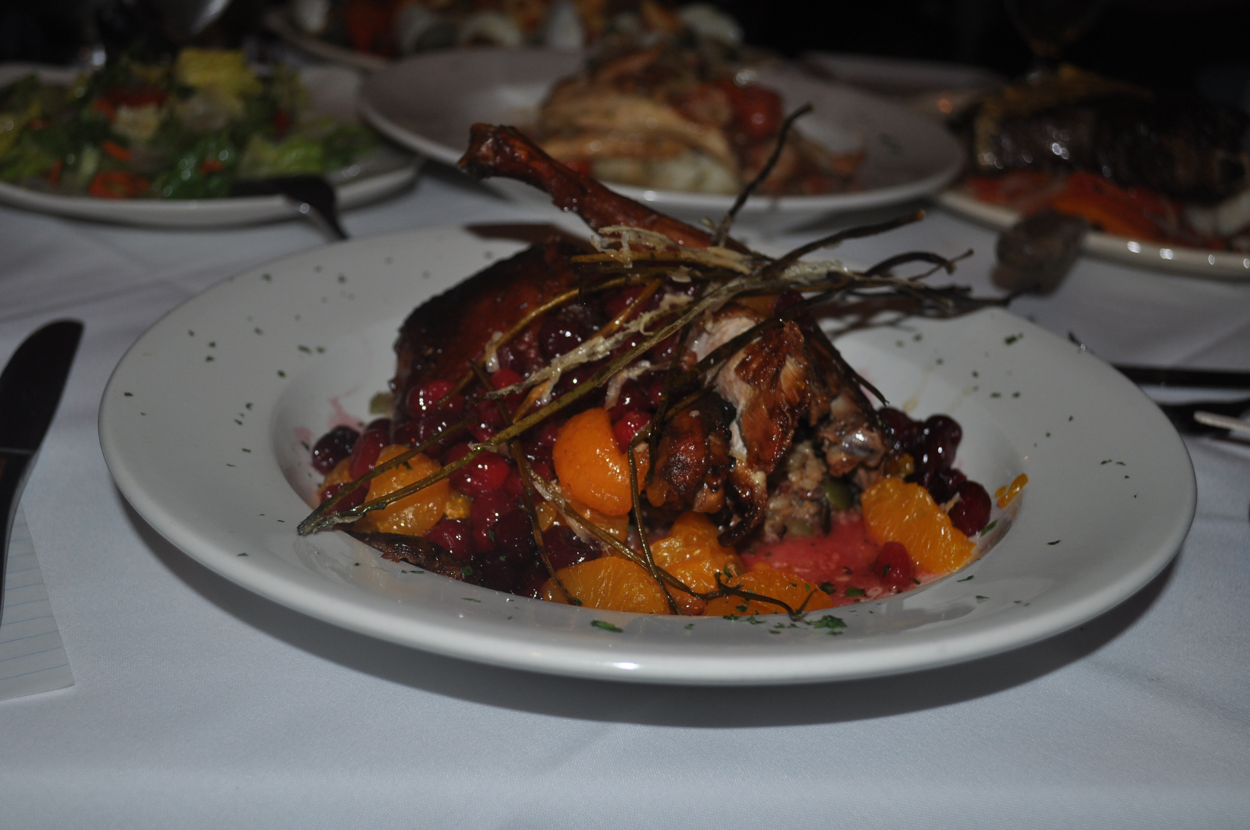 Fall-off-the-bone tender Long Island Duck, dressed in oranges, plump cranberries and toasted pumpkin seeds, is autumn incarnate.