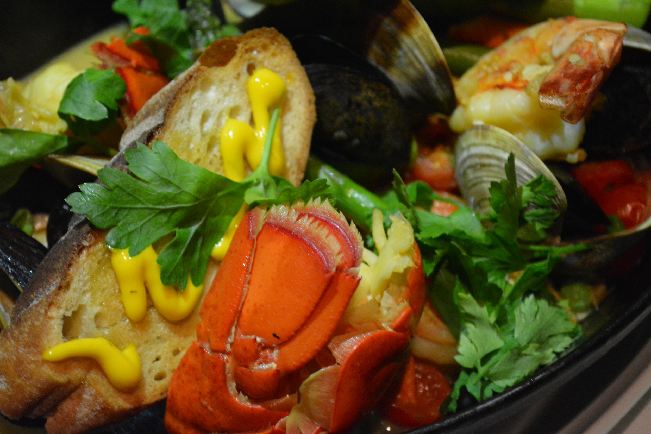 The lobster cioppino ($39) is colorful, consisting of lobster, shrimp, clams, mussels and saffron broth.