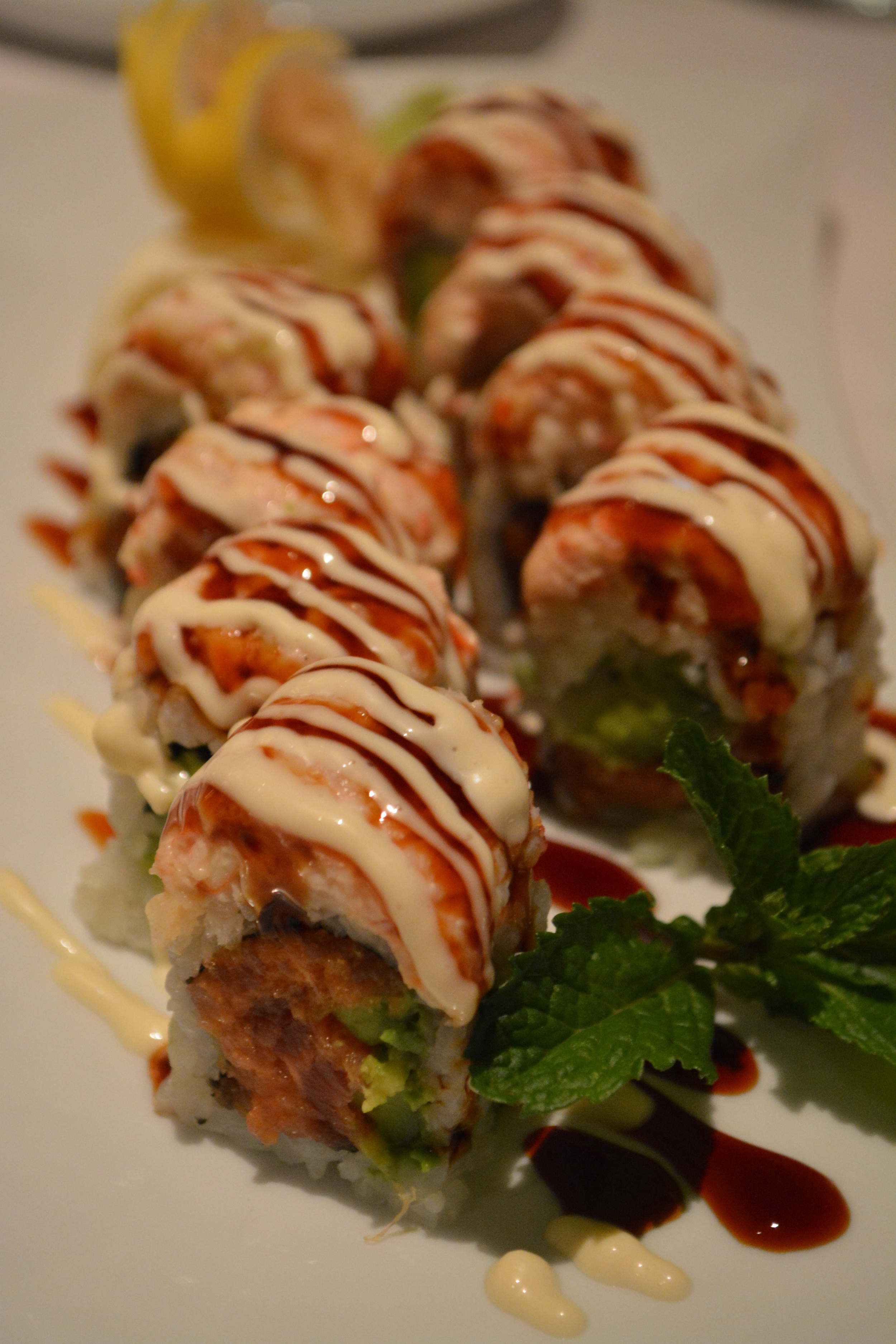 The Montauk Roll ($25) – spicy tuna, avocado, tempura crunch, topped with lobster, yuzu mayo and eel sauce