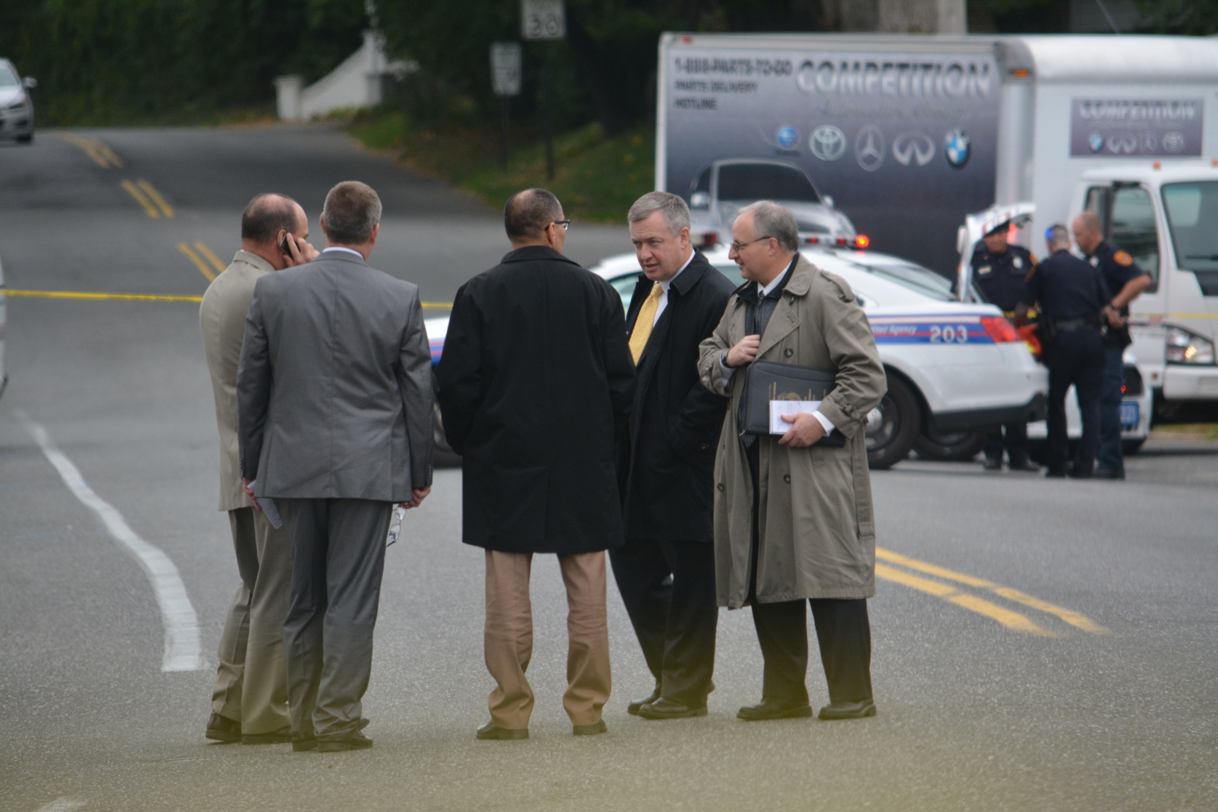 Detectives congregate at the crime scene where Rosales' body was found.