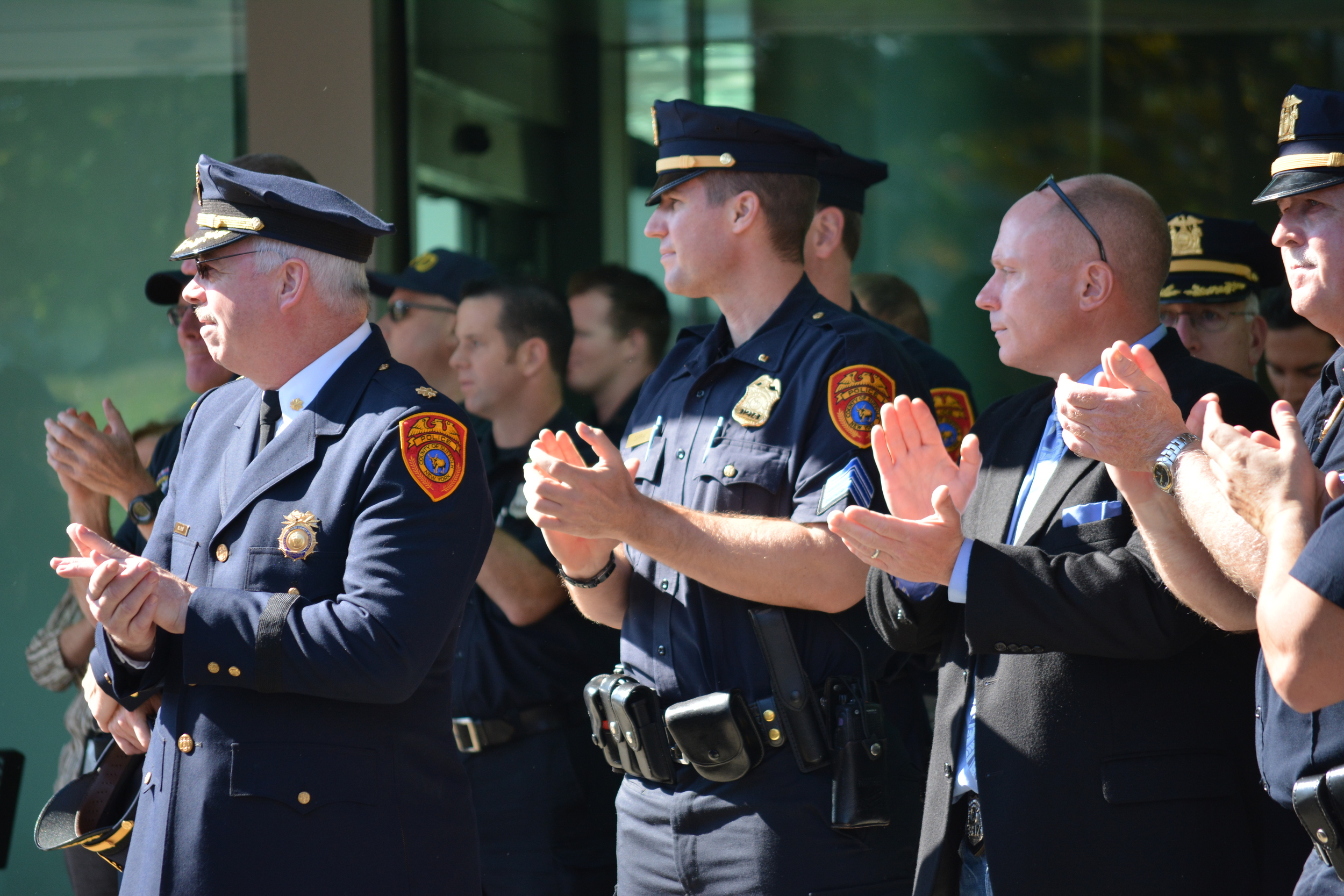 Suffolk County police officers give fellow Officer Nicholas Guerrero a round of applause on Friday as he is released from Stony Brook University Hospital following a hit-and-run that left him critically injured on Sept. 22.