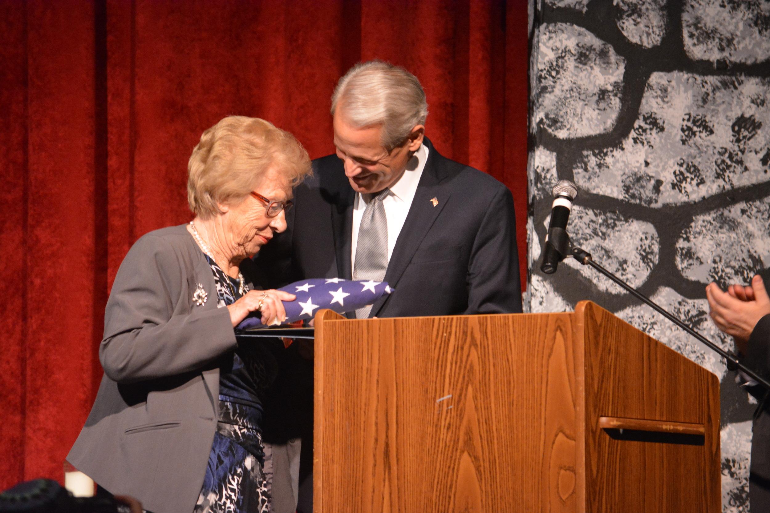 Congressman Steve Israel presents Holocaust survivor Eva Schloss with an American flag in Commack last week. (Long Islander News photo/Arielle Dollinger)