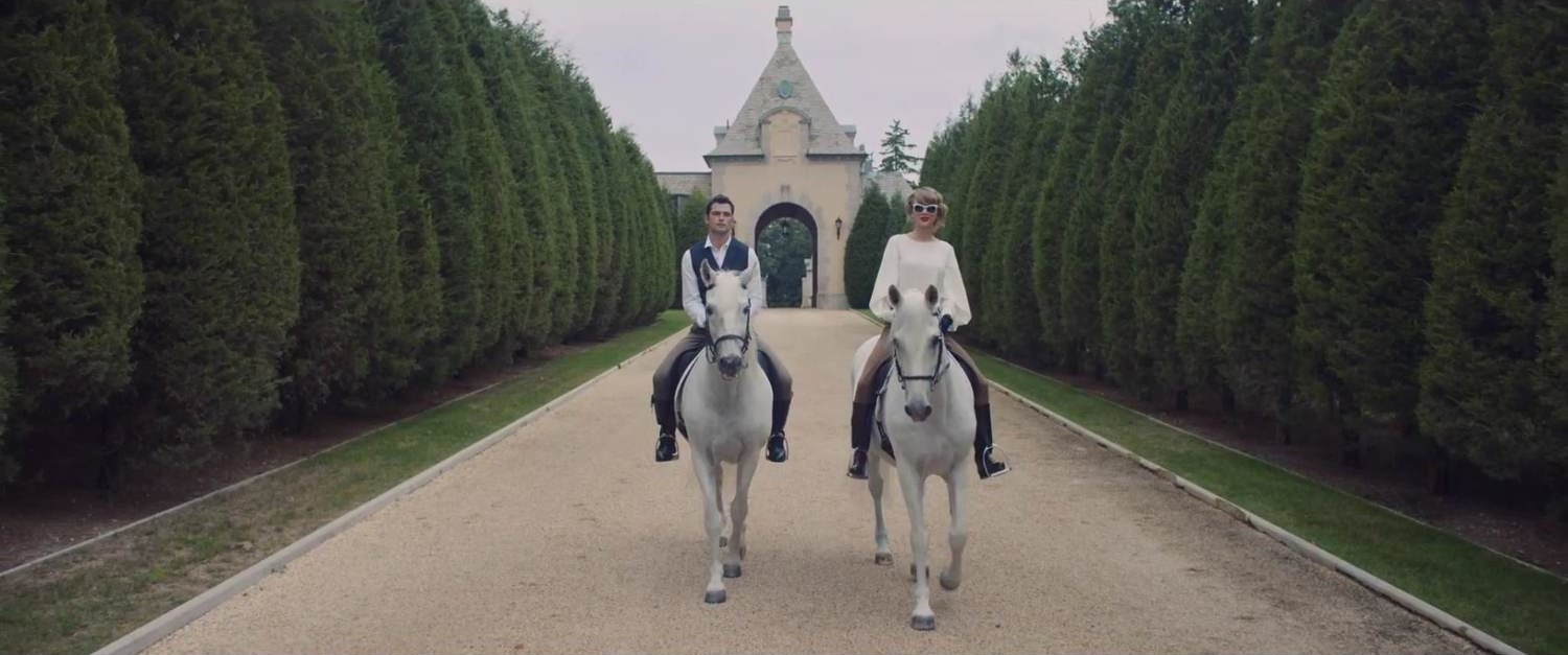 Taylor Swift, 24, and Sean O'Pry, 25, ride white horses down the distinctive tree-lined West Gate Drive.