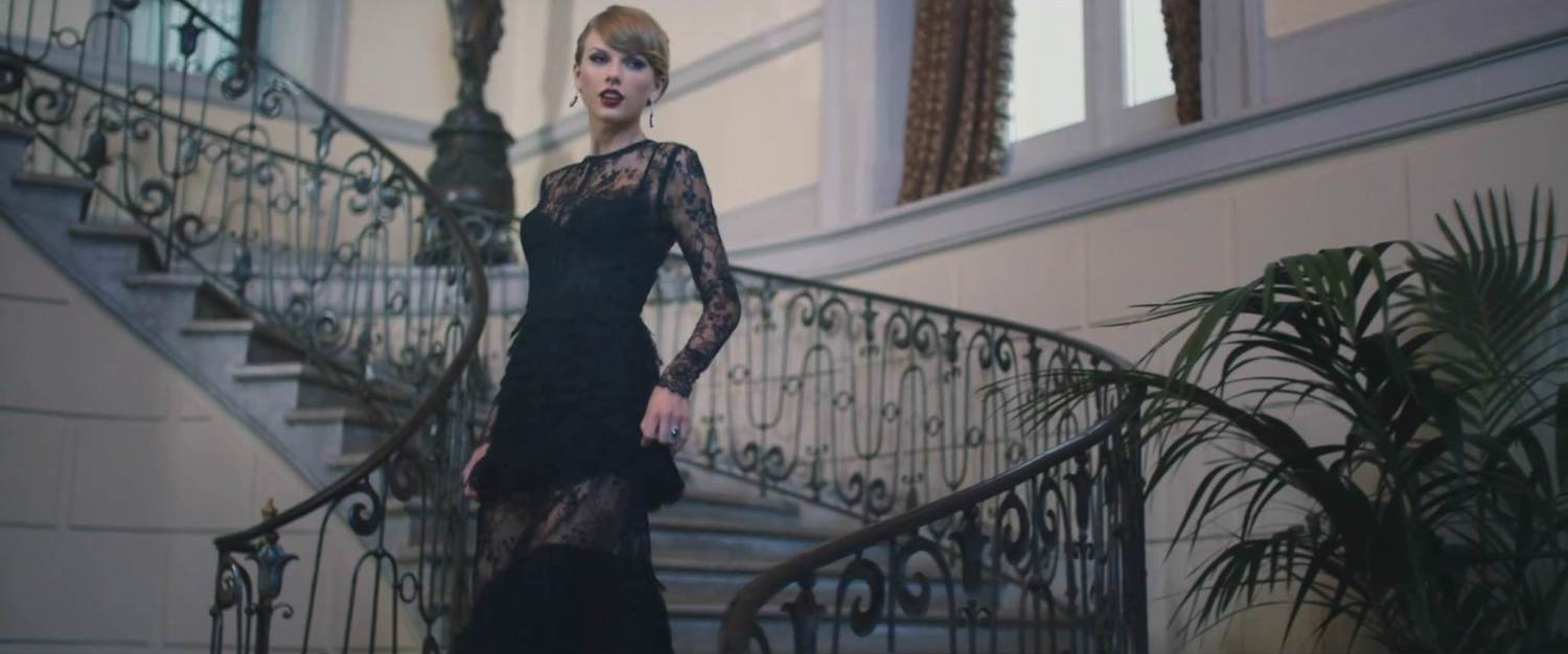 """Taylor Swift as she appears in her music video for """"Blank Space,"""" shot at Oheka Castle."""