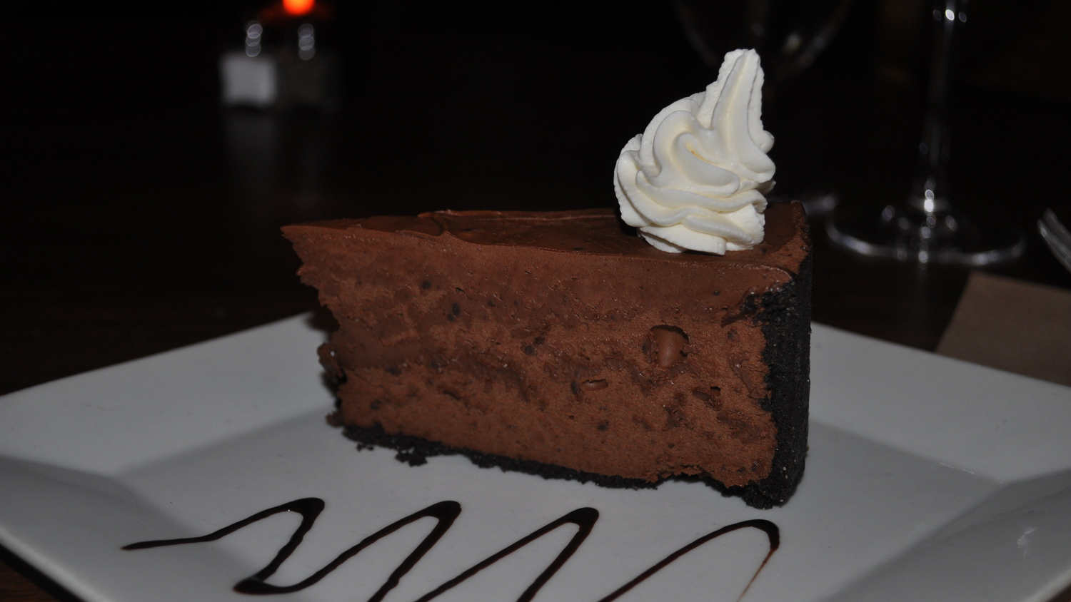 Finish a meal with semi-sweet Valrhona Chocolate Mousse Cake.