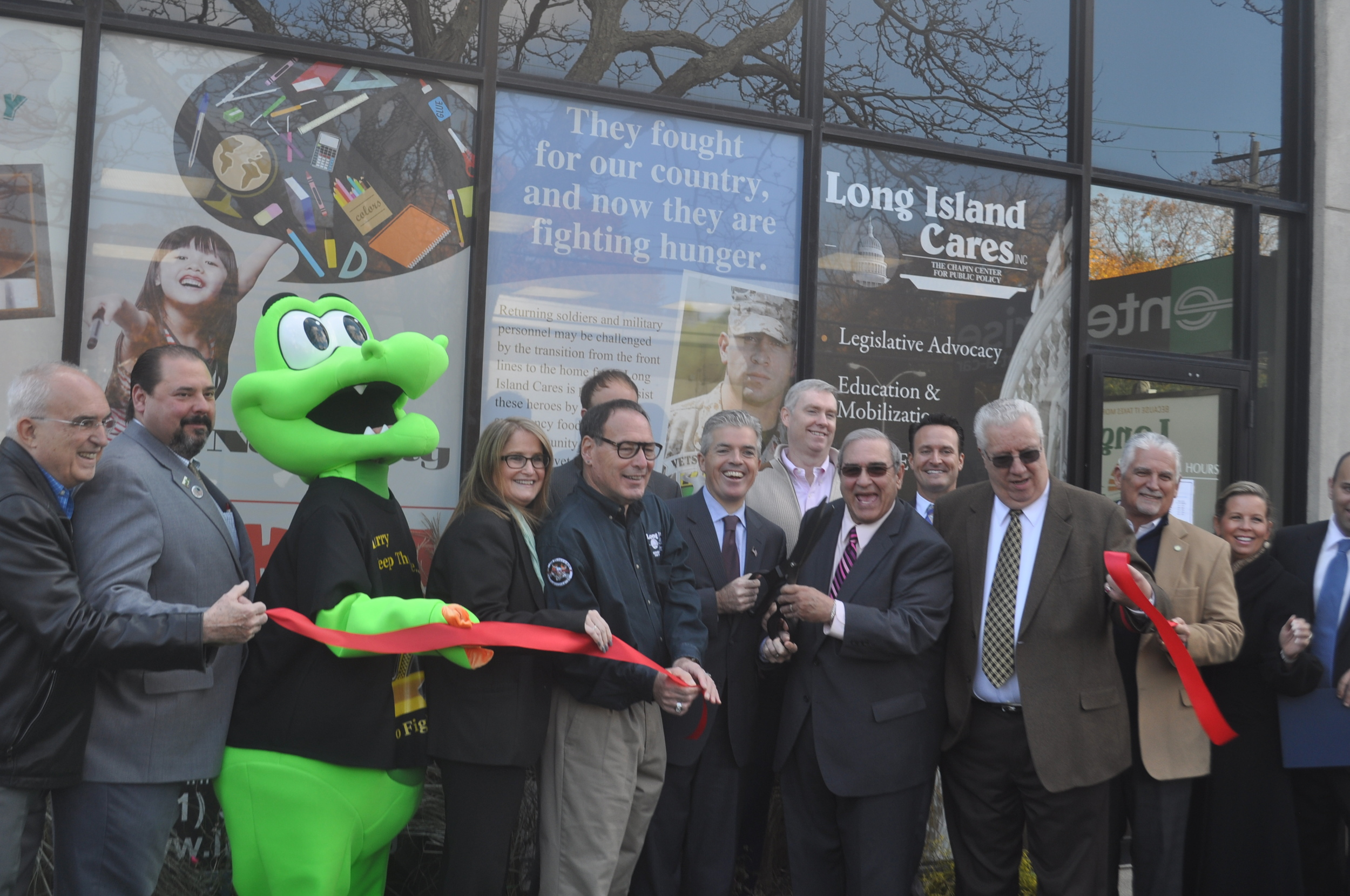 Elected officials join Long Island Cares CEO Paule Pachter in cutting the ribbon on the Harry Chapin Food Bank and Humanitarian Center in Huntington Station Friday.