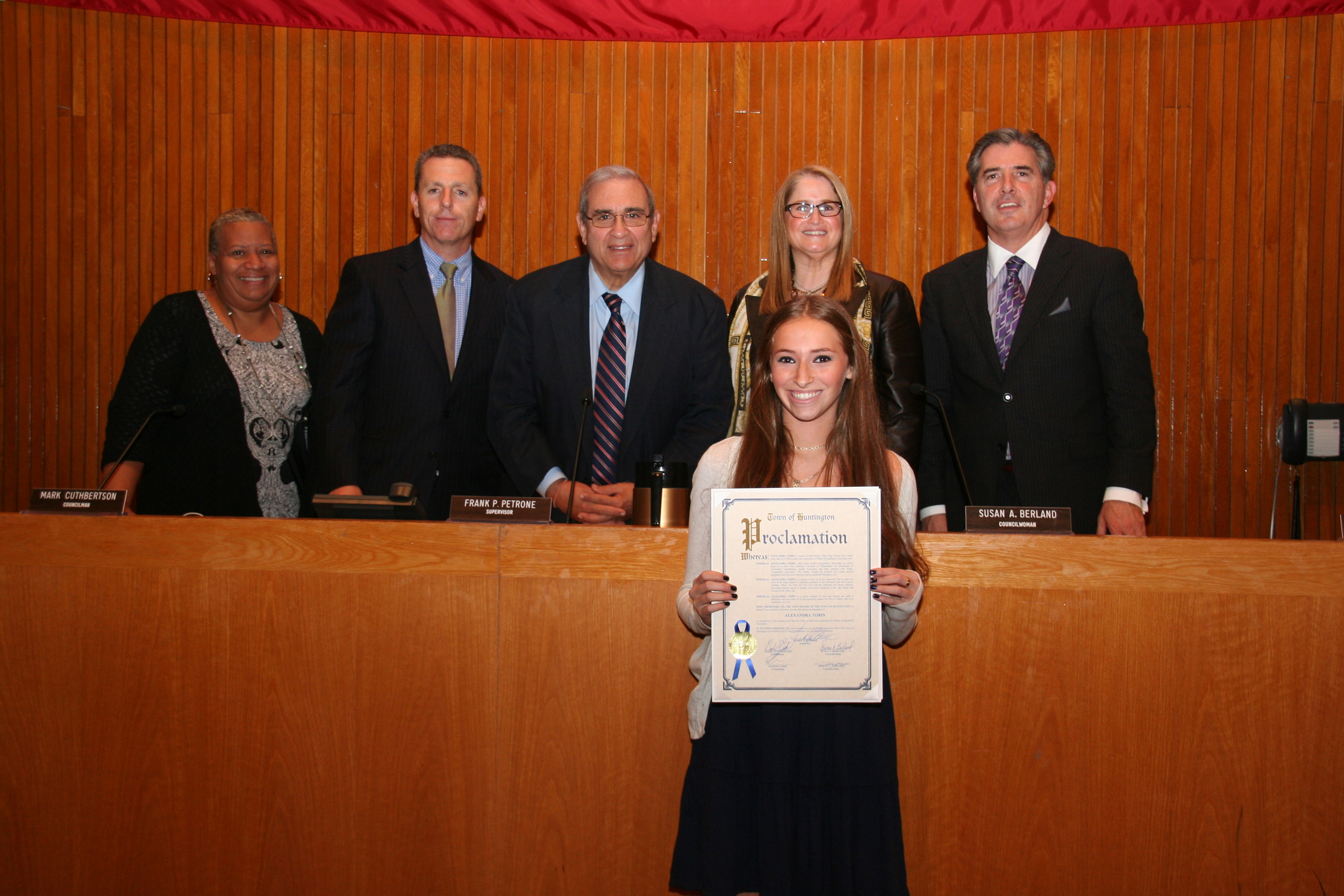 Alexandra Tobin, front, receives a proclamation from the Huntington Town Board during the Nov. 6 meeting for her fundraising cause that has generated more than $115,000 toward finding a cure for Reflex Sympathetic Dystrophy – a disease she suffers from.