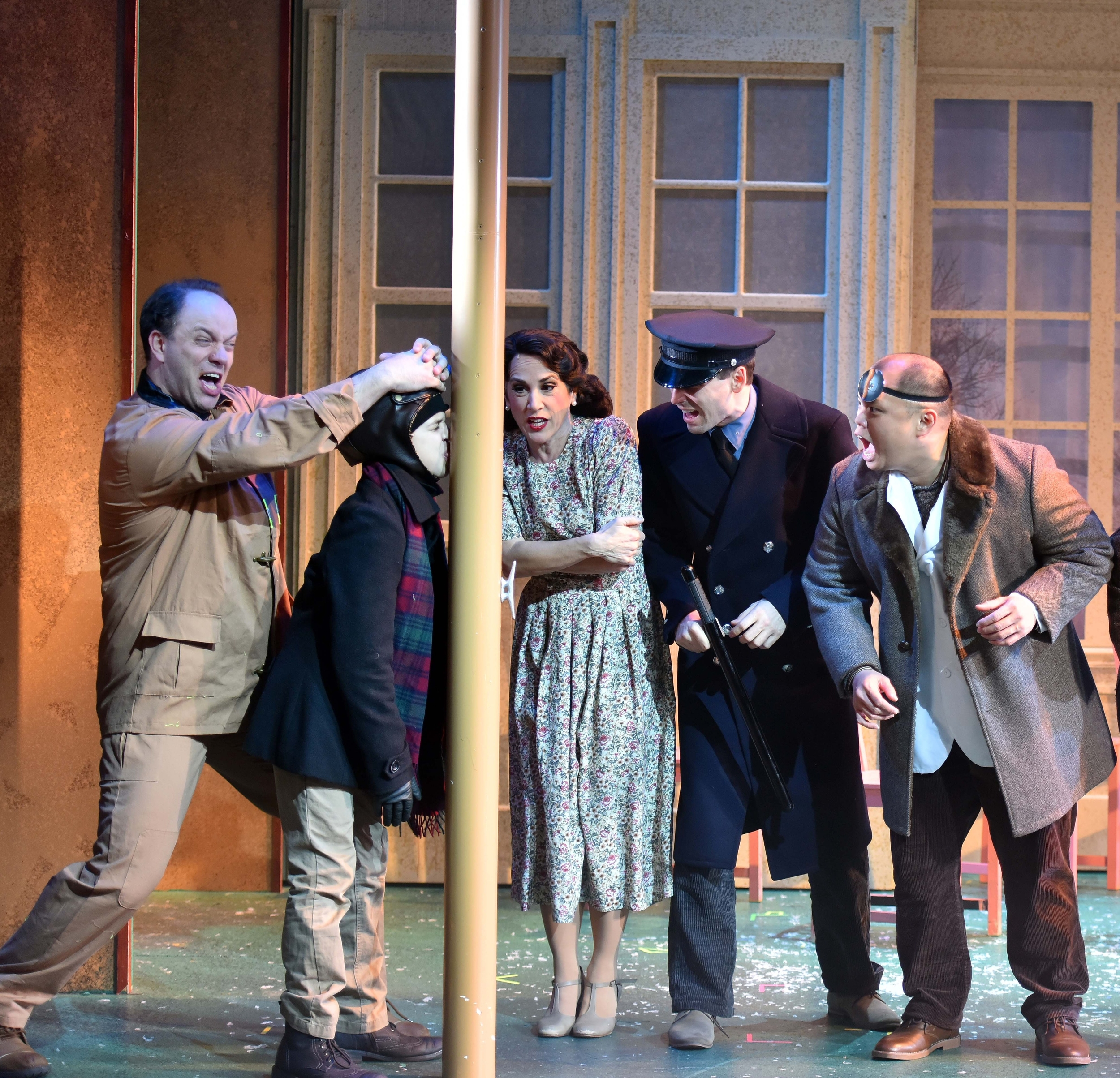 """Chad Jennings, Vincent Gerardi, Kathryn Markey, Larry A. Lozier, Jr. and Viet Vo in a famous scene from """"A Christmas Story."""" (Photo: Engeman Theater)."""