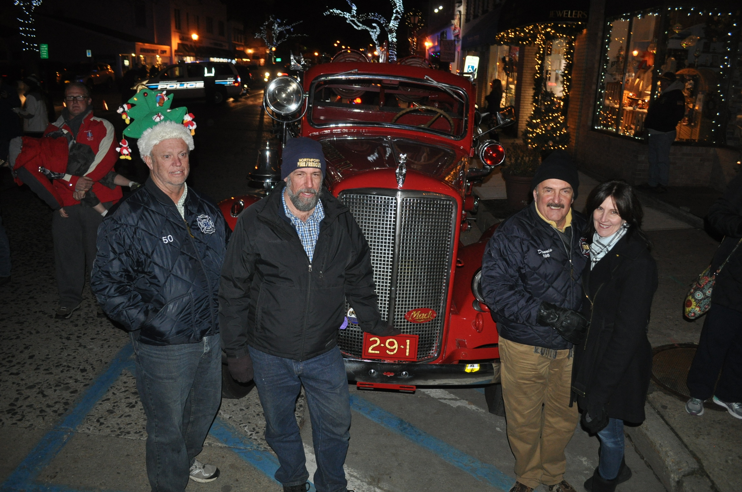 Northport Fire Department volunteers bring a vintage 1948 Mack truck to the festivities.