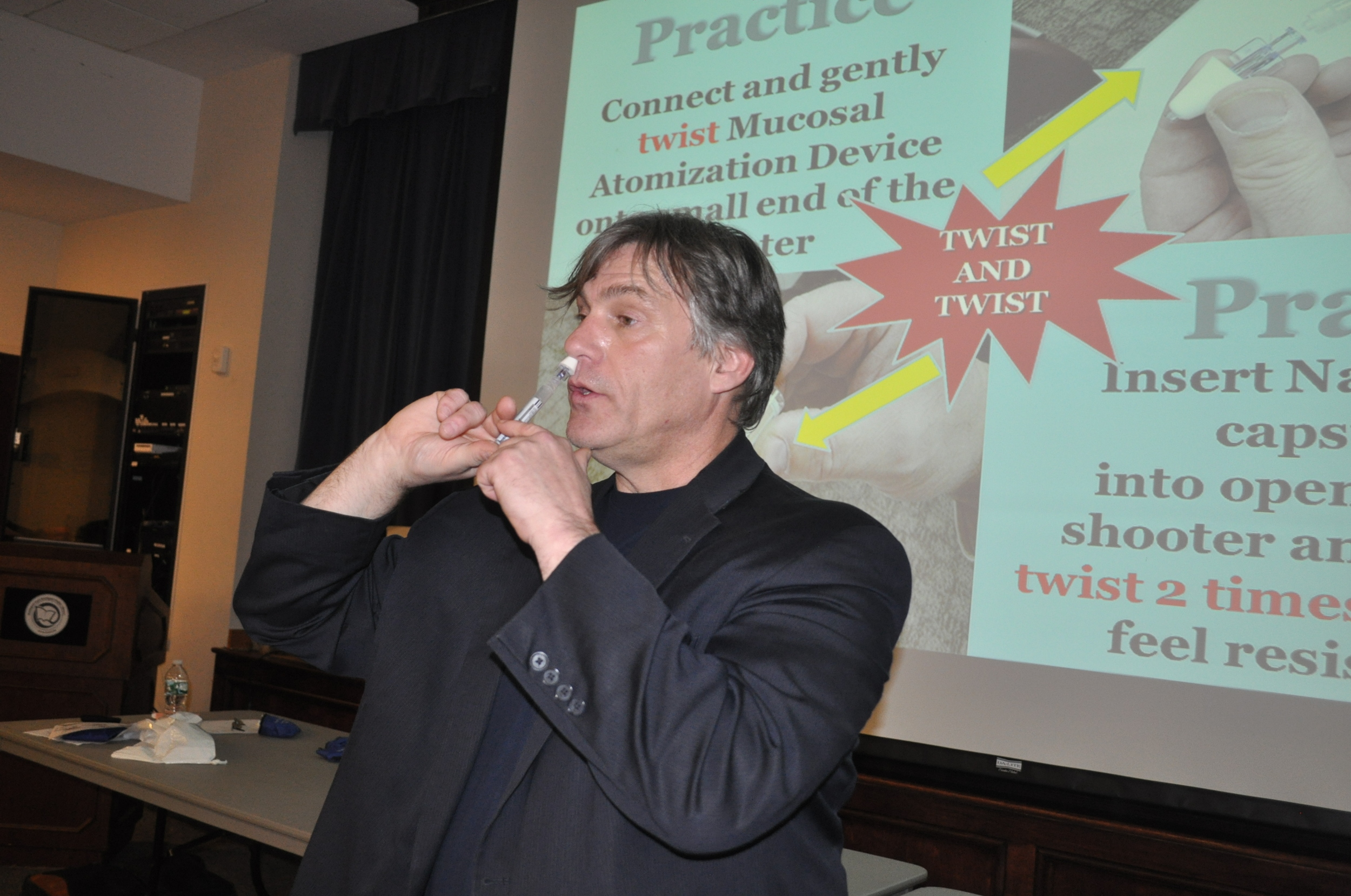 John T. Martin, a senior public health educator for Suffolk County, demonstrates the nasal administration of the drug overdose antidote Narcan.
