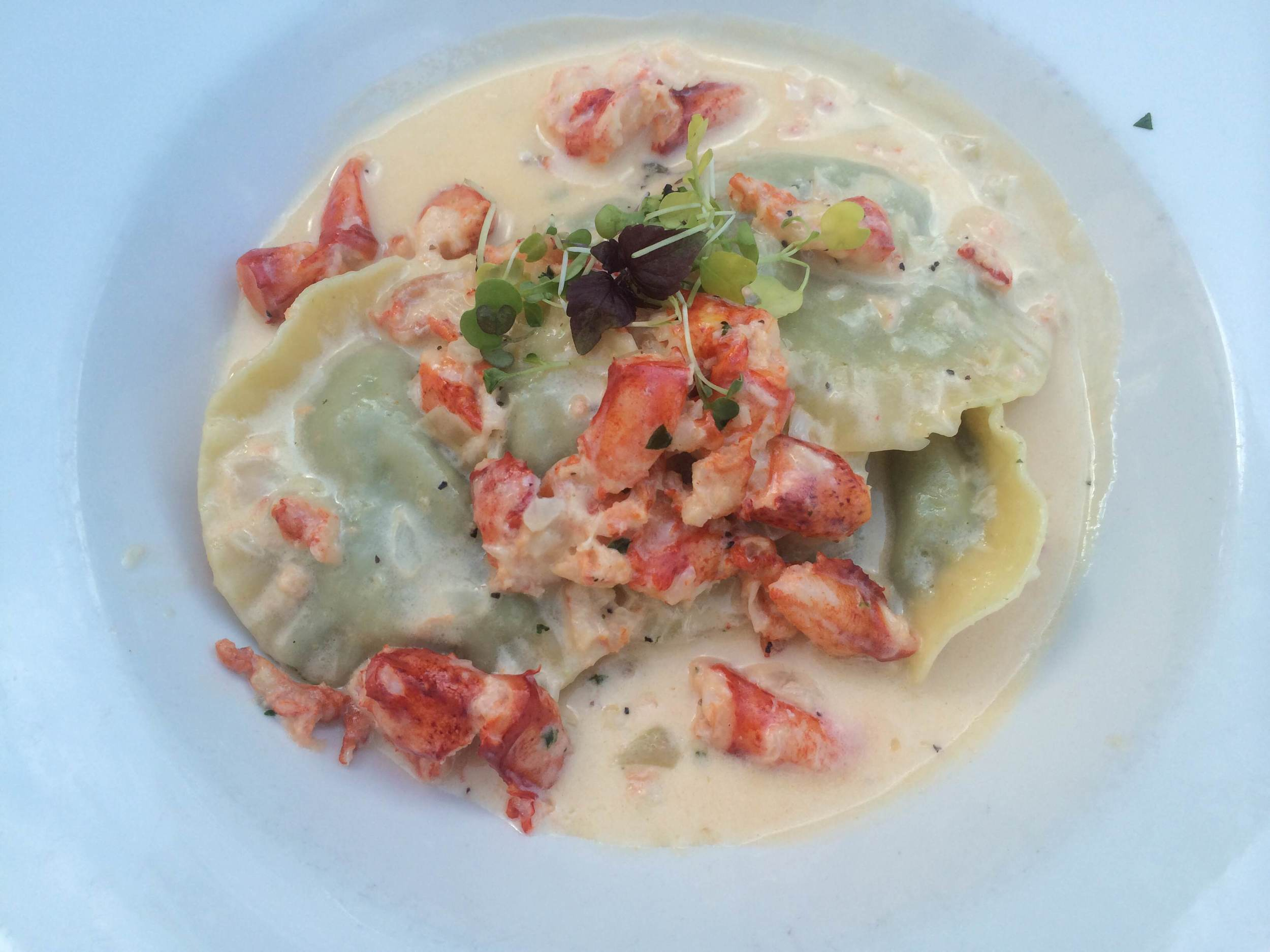 Lobster over spinach ravioli ($25) at Bistro 44 (44 Main St., Northport, 631-262-9744, Bistro44.net).  Long Islander News photo/ Arielle Dollinger