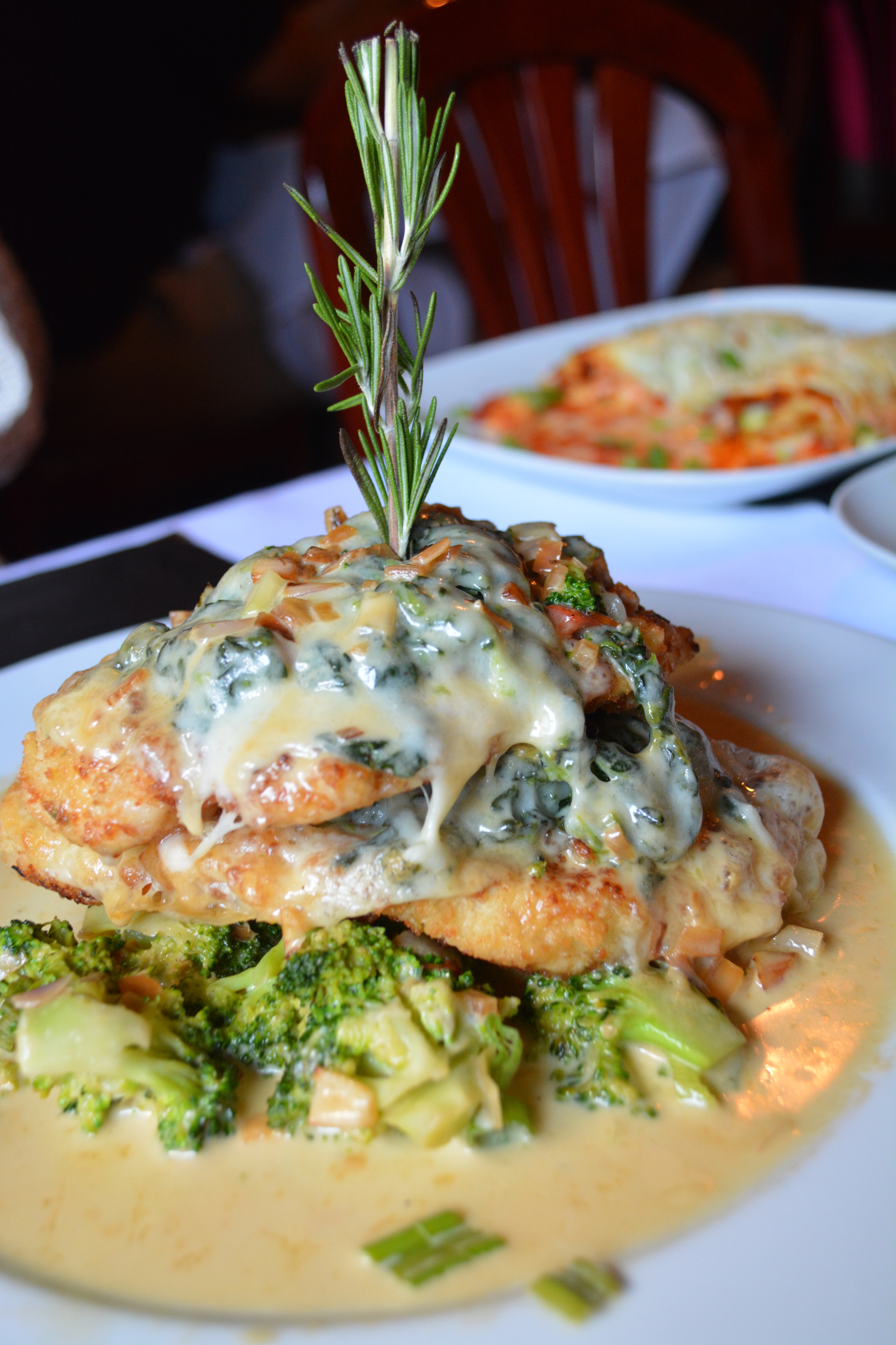 The Pollo Provolone ($24) at Sur is served in a shallot and broccoli cream sauce.     (Sur Argentinian Steakhouse, 314 New York Avenue, Huntington, 11743. 631-470-6300)  Long Islander News photo/ Arielle Dollinger