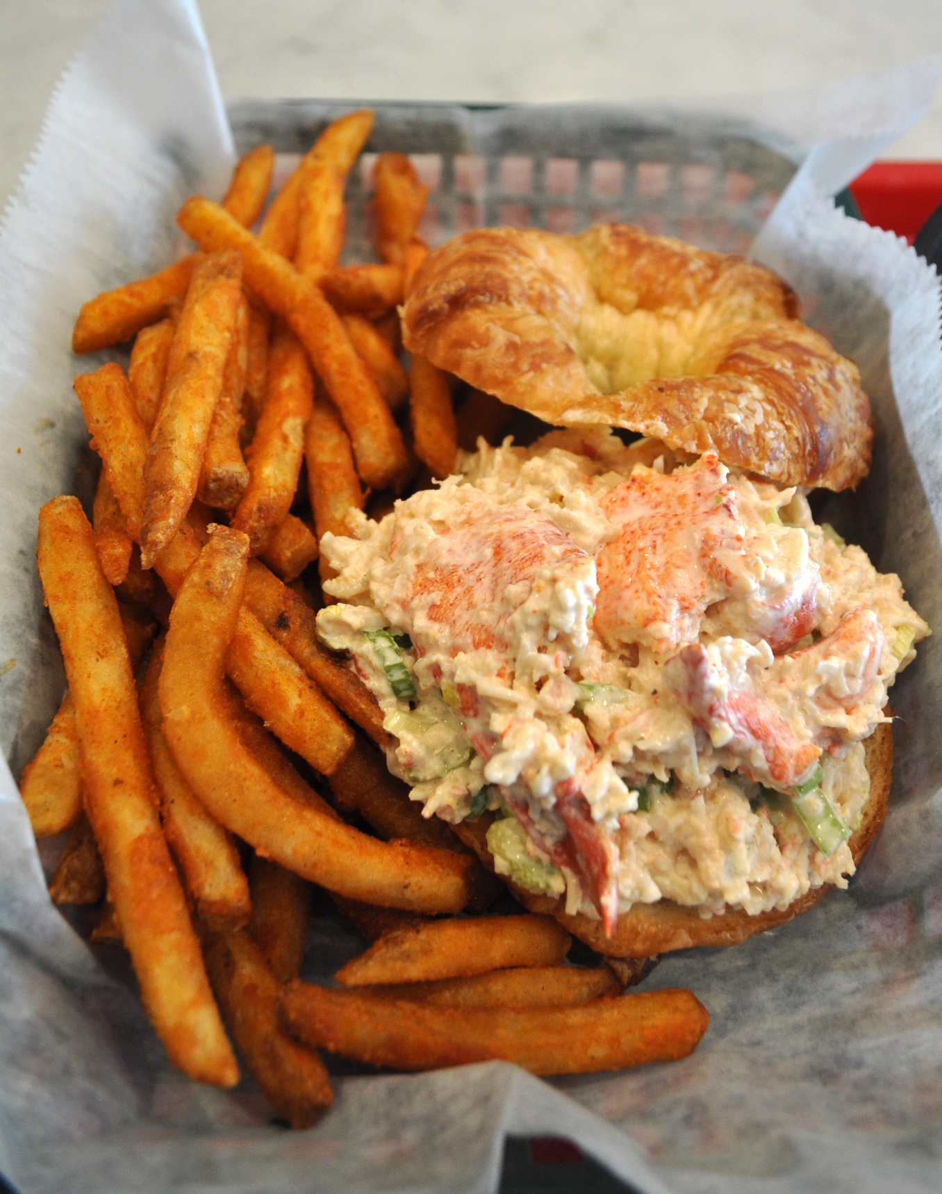 The Lobster Croissant Sandwich ($18) at Jeff's Surf and Turf -- big chunks of premium lobster meat stuffed into a flaky, buttery croissant – is a decadent delight. (Jeff's Surf and Turf, 217 New York Ave., Huntington, 631-423-6300)     Long Islander News photo/ Danny Schrafel