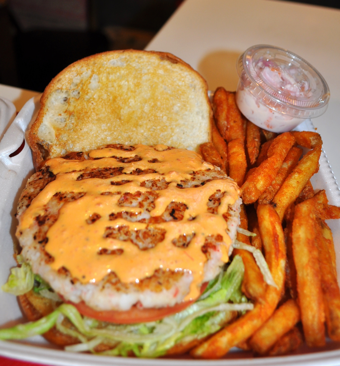 A shrimp and scallop burger at Jeff's Surf and Turf. (Jeff's Surf and Turf, 217 New York Ave., Huntington, 631-423-6300)  Long Islander News photo/ Danny Schrafel