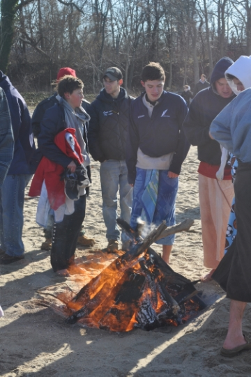Towels and campfires are some of the techniques the chilly revelers used to thaw out.