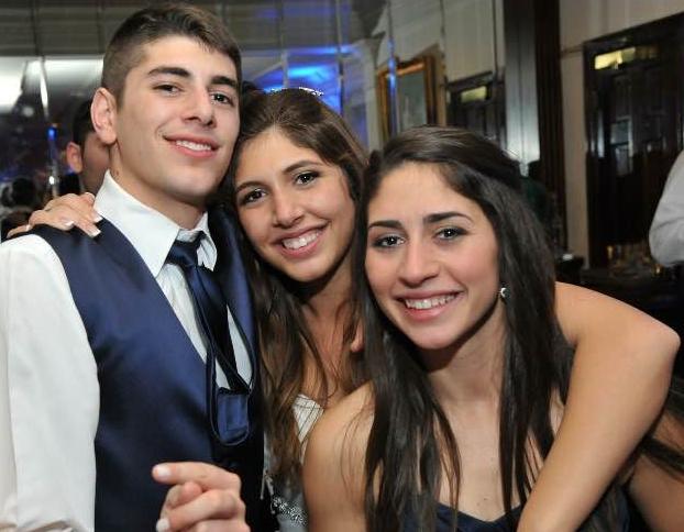 John Bosco with siblings Amanda and Angela at Amanda's wedding in 2014.
