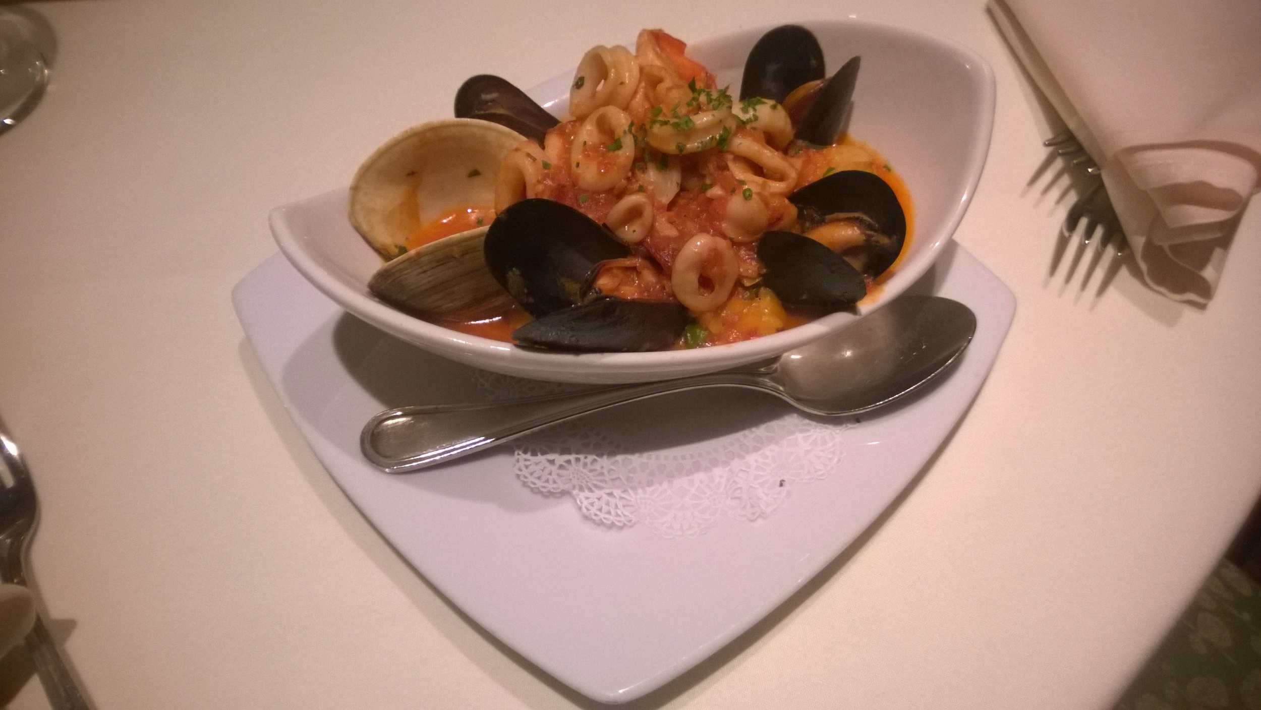 Seafood paella evokes images of Valencia, Spain.