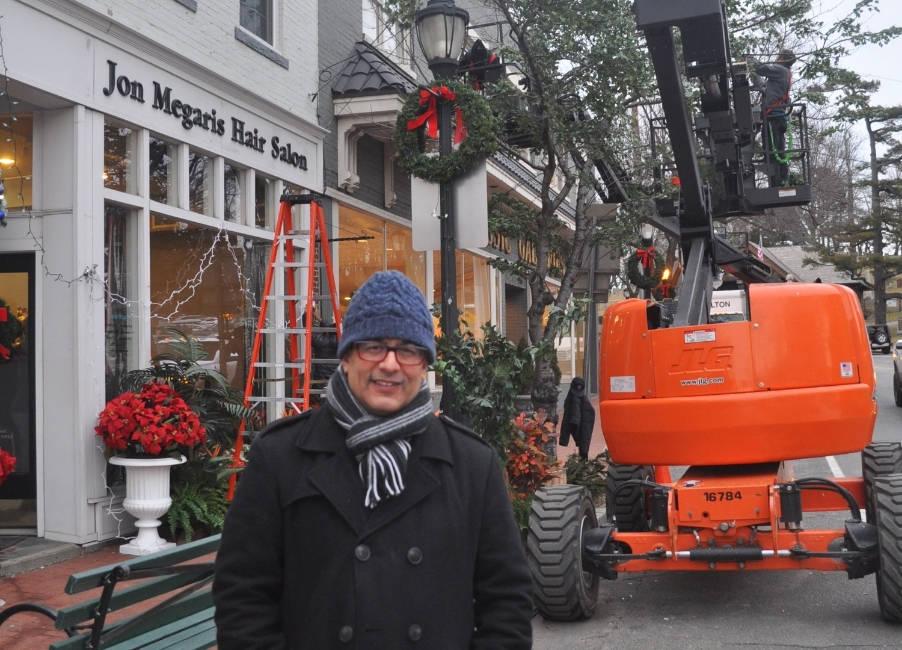 "Owner Tasso Megaris stands outside of the Jon Megaris Salon Wednesday as a film crew transforms the Main Street salon ahead of filming for the Tina Fey/Amy Poehler comedy, ""Sisters."""
