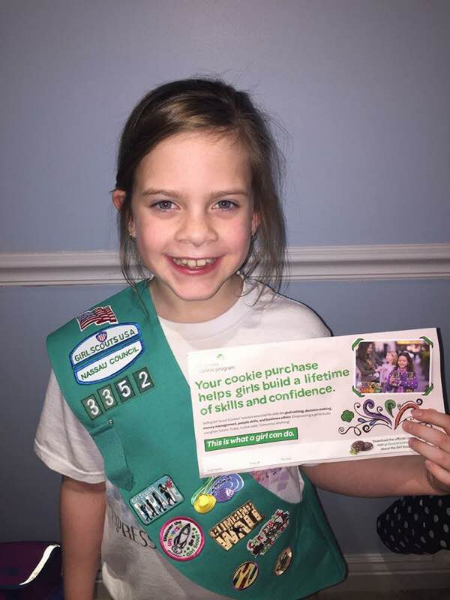 Long Island Girl Scout Caitlin Ganci, 9, is one of many who have been selling cookies during the Girl Scouts' largest annual fundraiser.