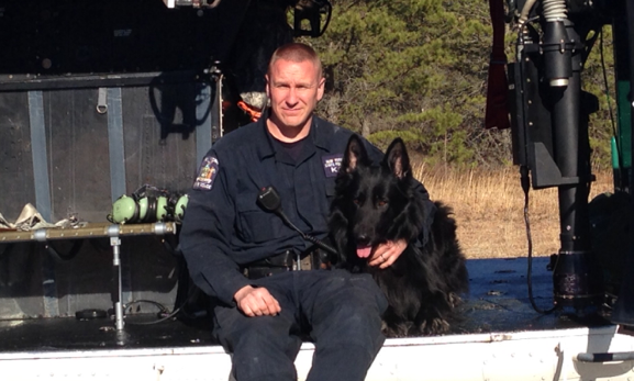 State Trooper Christopher Nolan, pictured with his K9 partner Reddy, is credited with saving a choking 6-year-old boy on the Southern State Parkway Jan. 3.