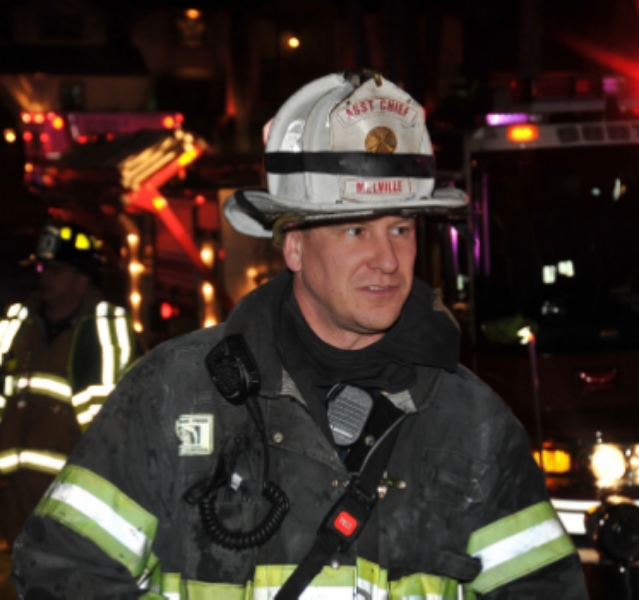 In addition to his work as a state trooper, Nolan serves as third assistant chief of the Melville Fire Department. (Photo by Steve Silverman)