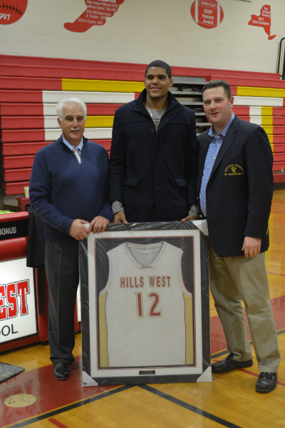 Tobias Harris, center, has his number retired by Half Hollow Hills High School West on Jan. 22. He is joined by Athletic Director Joseph Pennacchio, left, and his former head coach, Bill Mitaritonna.
